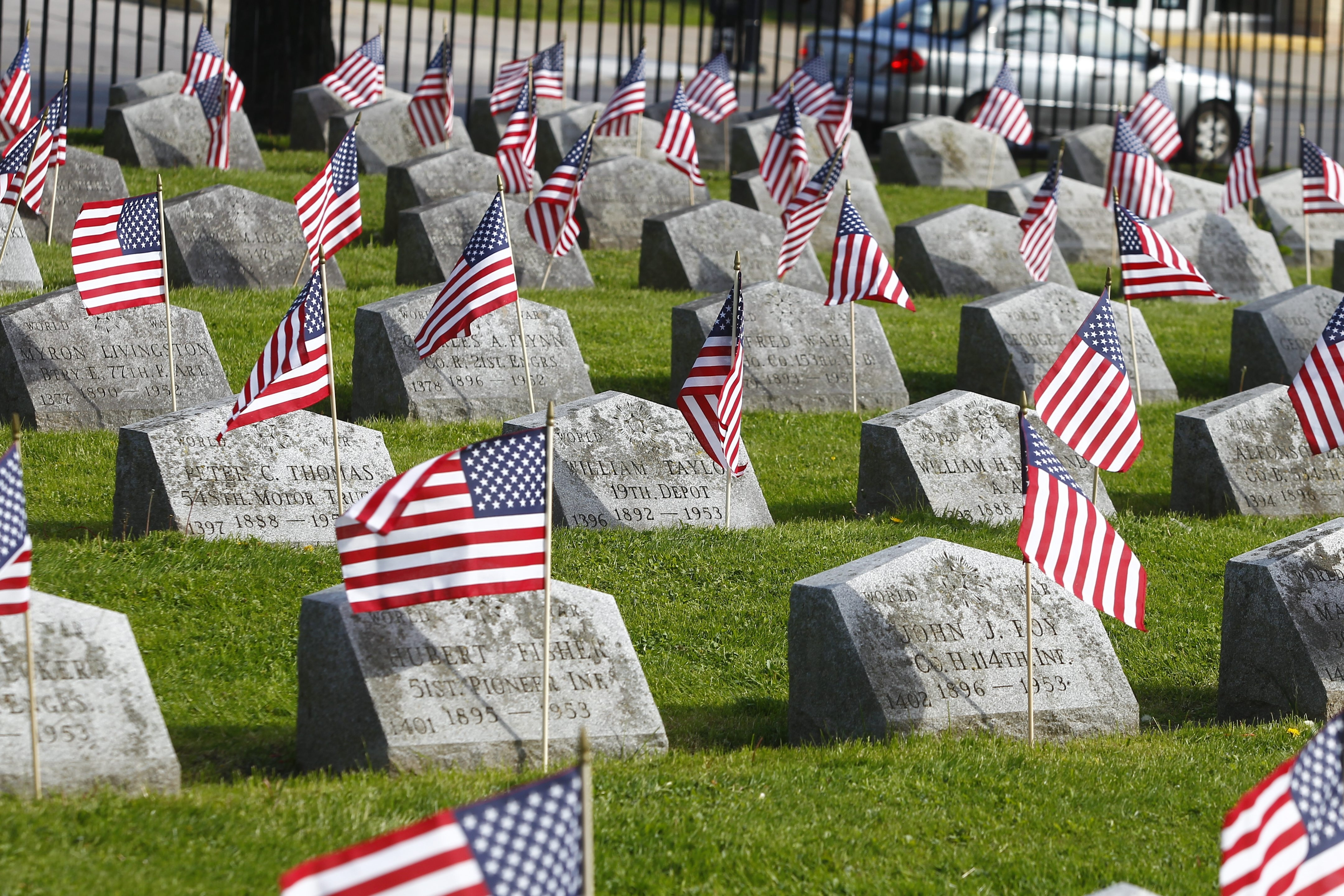 Flags fly in the breeze over the graves of fallen soldiers in the veterans' section of Forest Lawn in Buffalo on Monday. Sen. Charles E. Schumer announced today that the Department of Veterans Affairs has picked a 132-acre parcel of land in Pembroke to serve as Western New York Veterans' Cemetery.