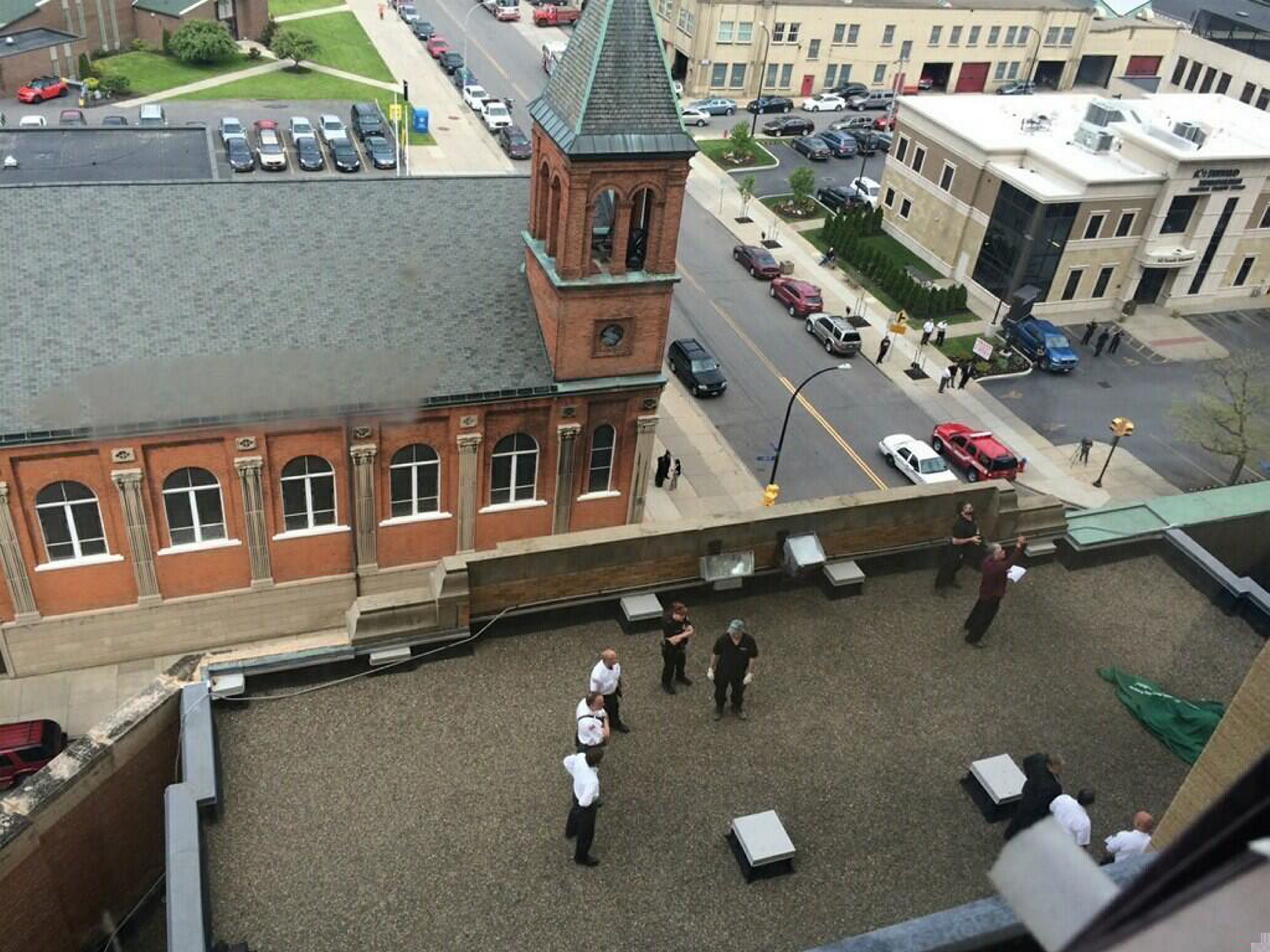 Officials recover a body from the fifth-floor terrace of City Hall.