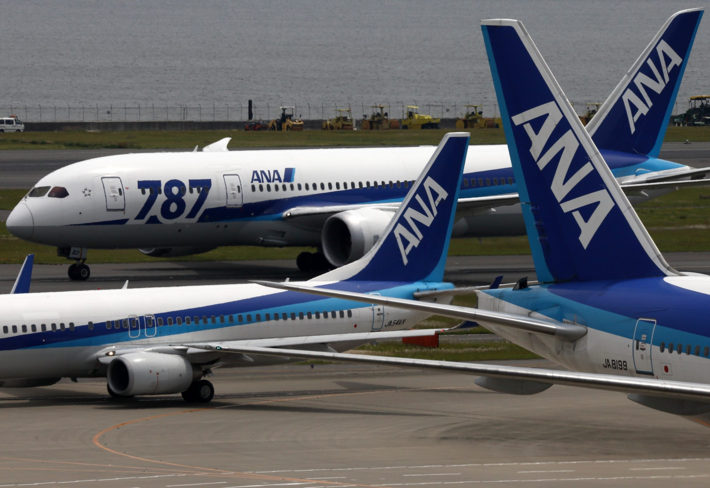 A Boeing Co. 787 Dreamliner taxies past aircraft at Haneda Airport in Tokyo Monday.
