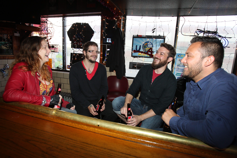 Jacqualan Dorman, left, Greg Rivera, Matt Brautlacht and Joe Verrastro hang out at Cigar's Bar on Seneca Street.