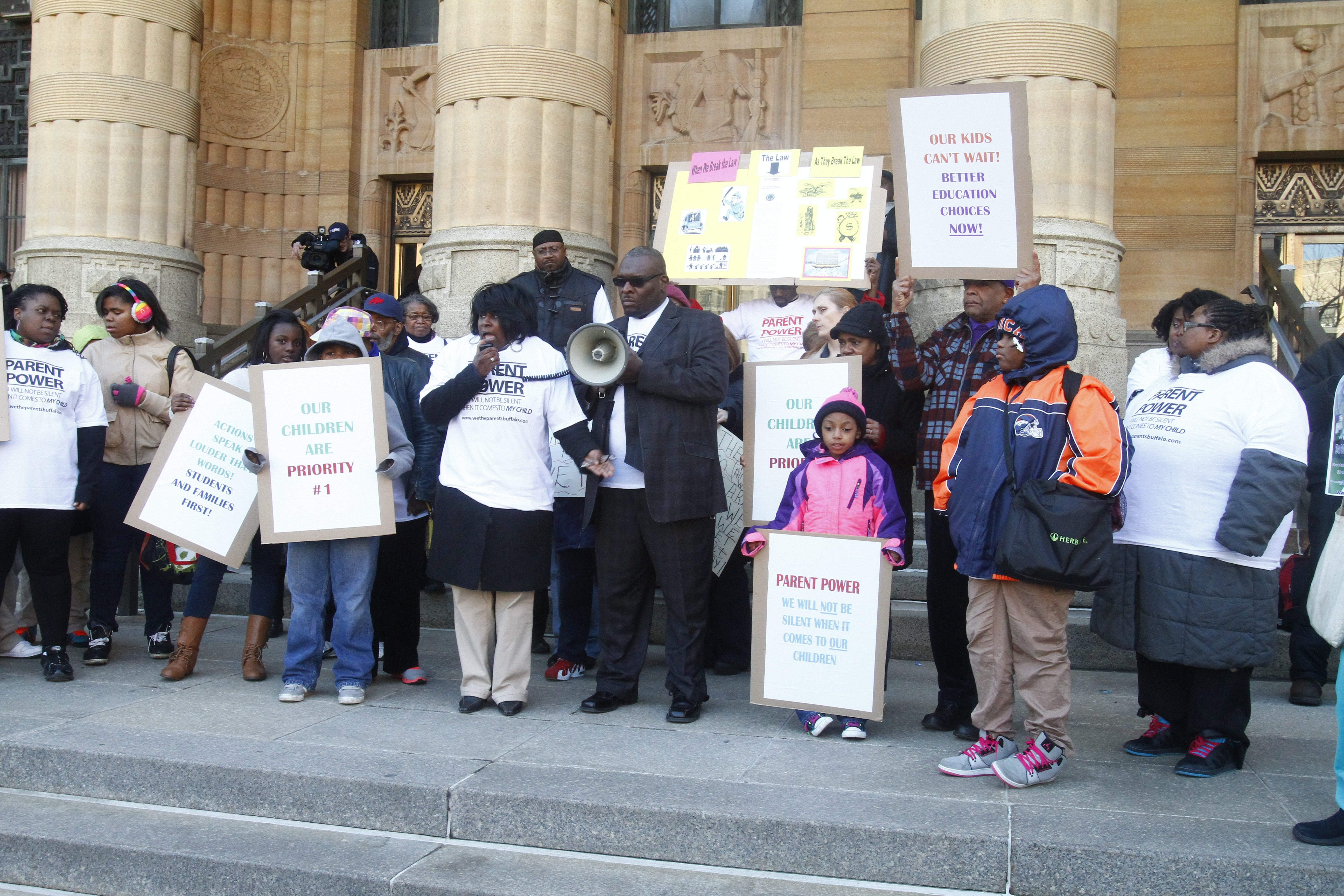 Members of We the Parents Buffalo and the District Parent Coordinating Council rally outside City Hall to call for better educational opportunities on April 23.