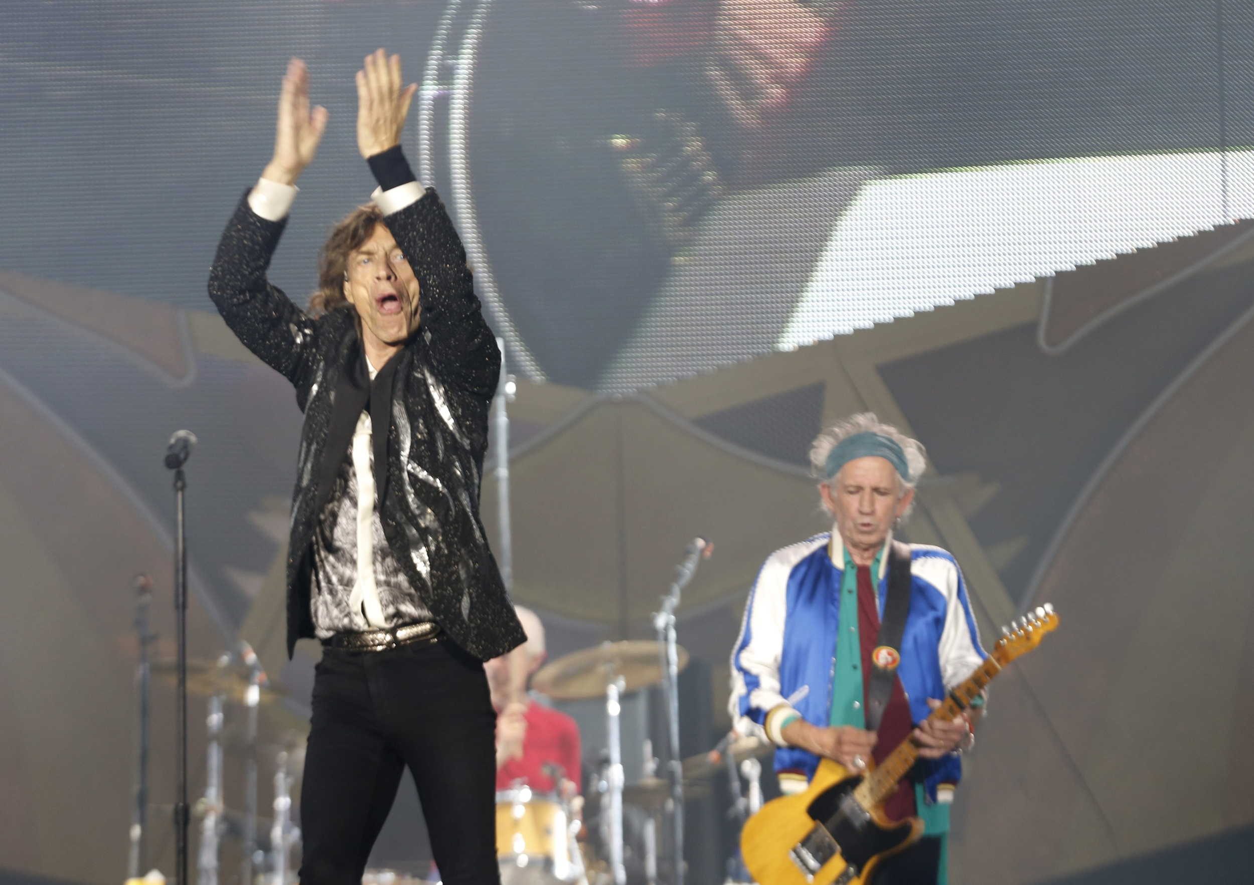 Stones rock out: Mick Jagger, left; Keith Richards, right; and  Charlie Watts, behind, perform during a Rolling Stones concert near Oslo, Norway, on Monday.