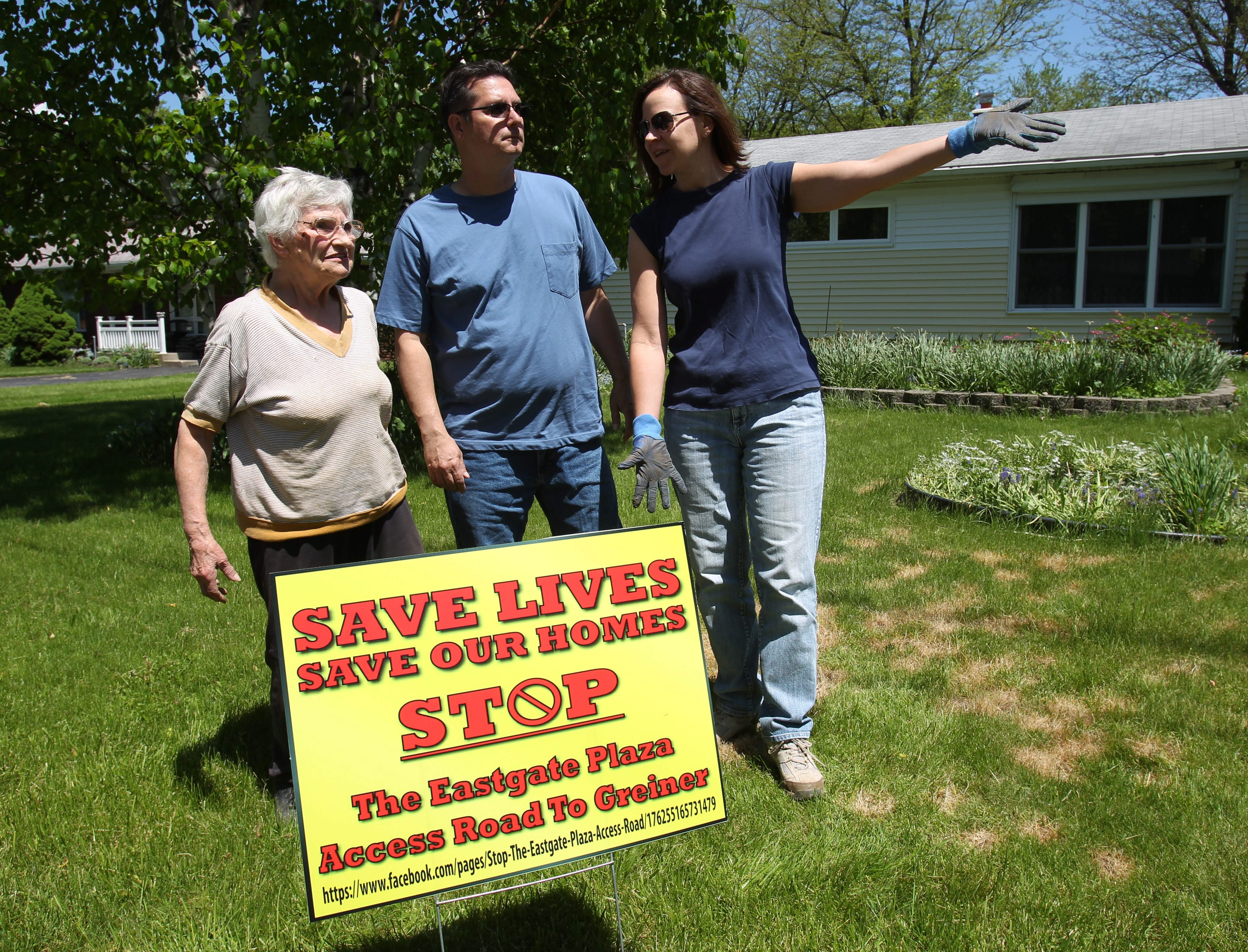 Greenhurst Road residents Gertrude Guth, left, Mario Candino and Tracy Kuchta discuss the egress issue at Guth's house.