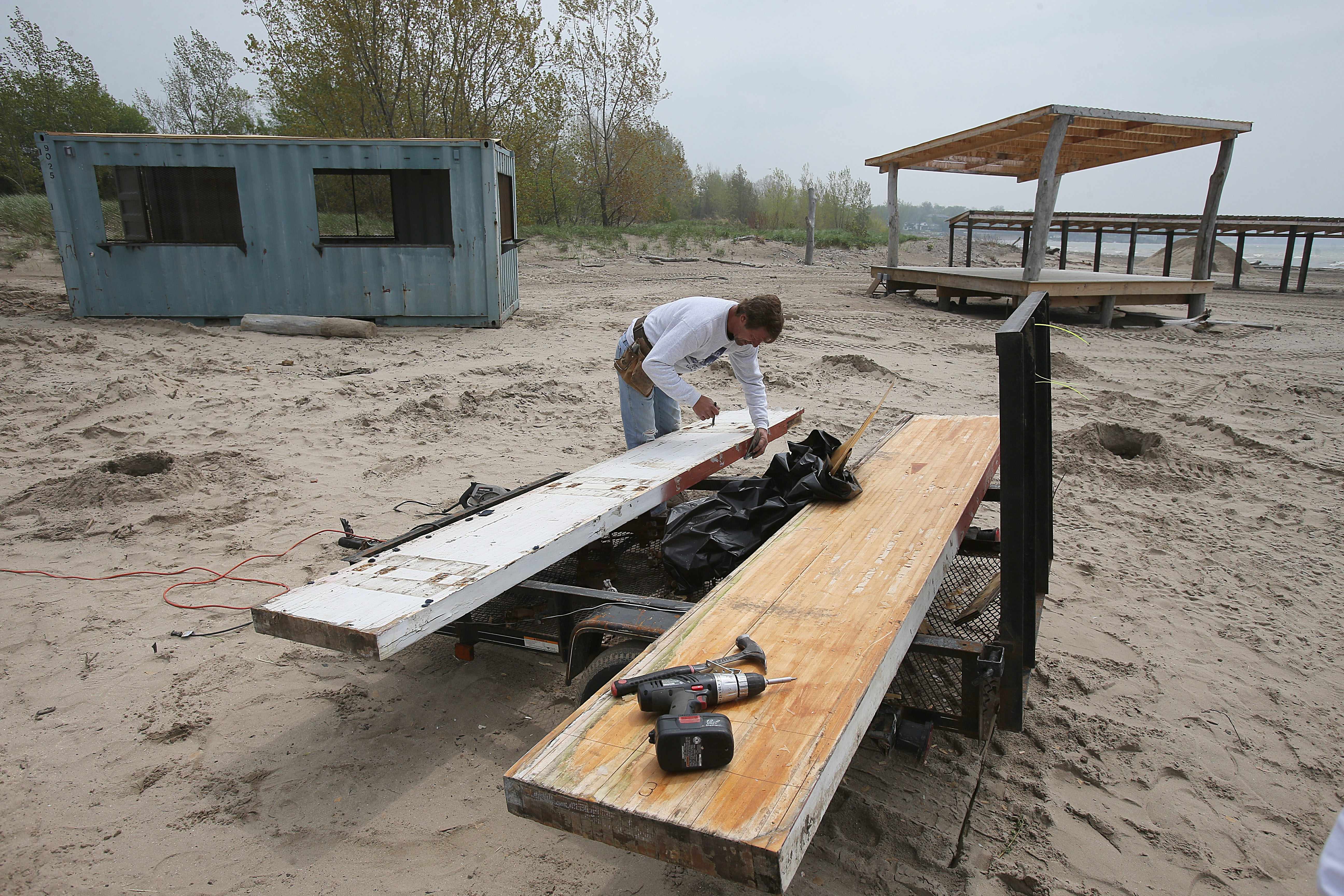 William Pike works on construction of one of the new outdoor bars at Woodlawn Beach State Park in Hamburg on Thursday.