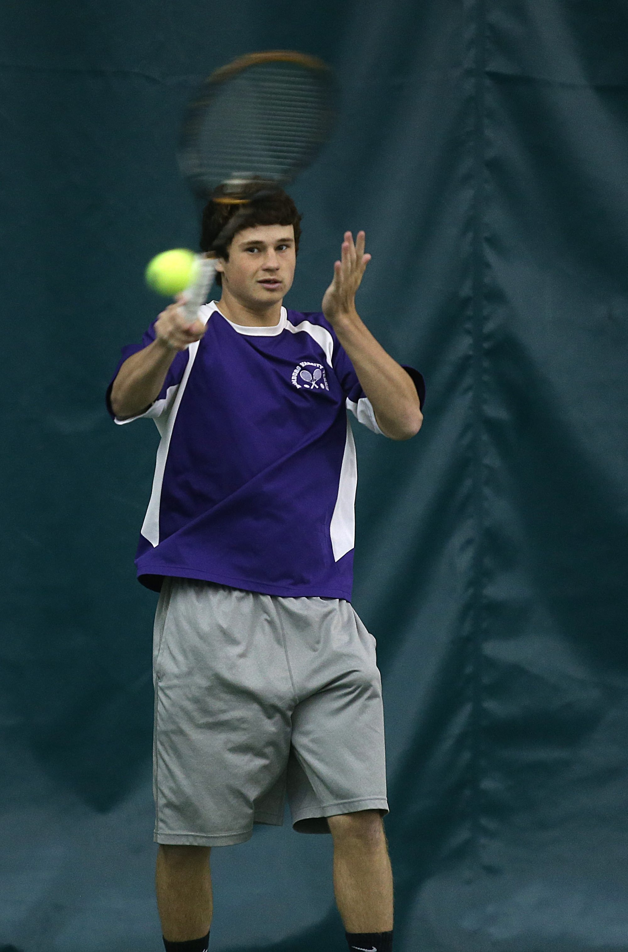 Timothy Kane, of Hamburg, warms up before his final match in the Section VI tennis championships Friday.