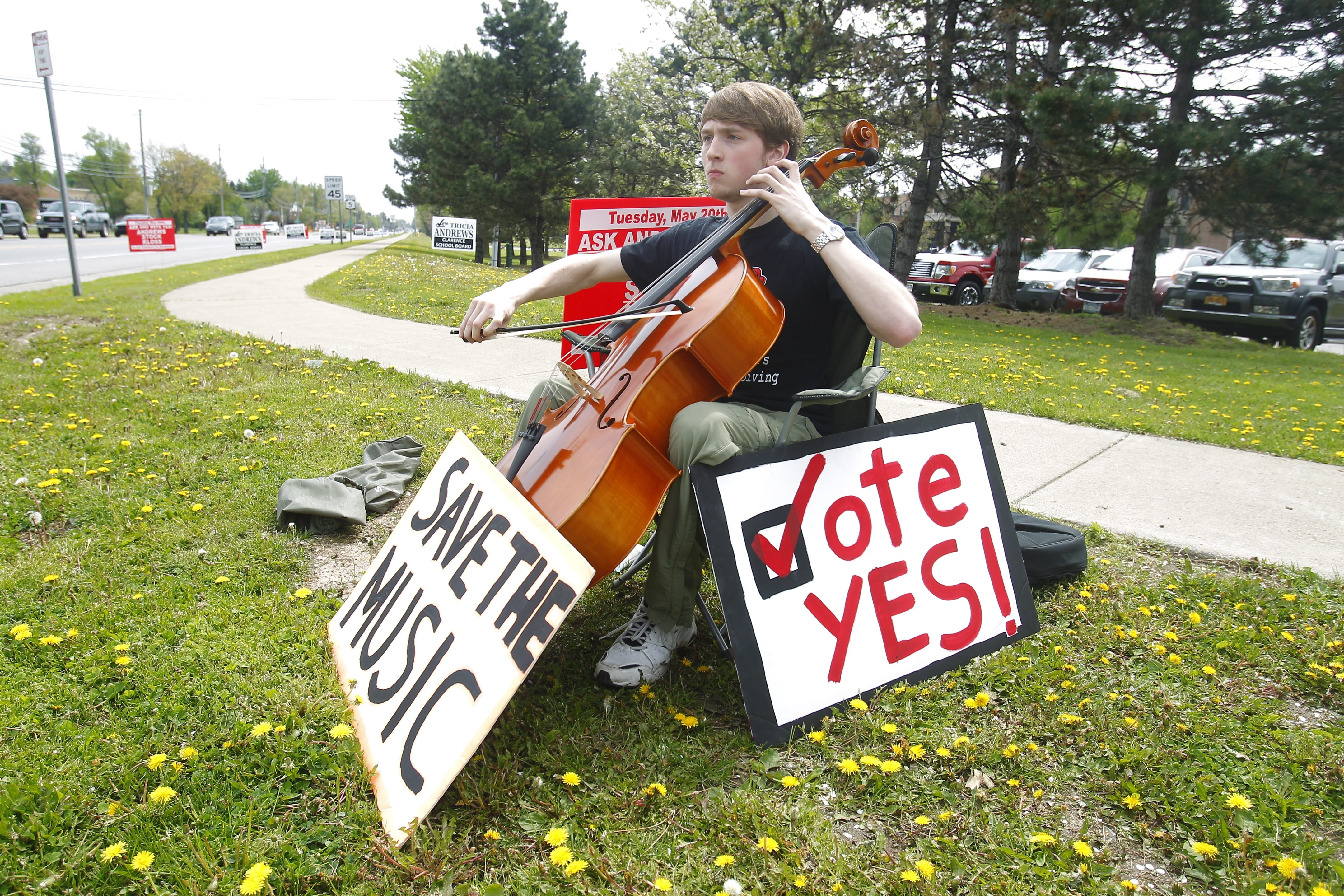 Andrew Cassidy played the cello Tuesday while urging Clarence residents to vote for the school budget, which passed easily. (John Hickey/Buffalo News)