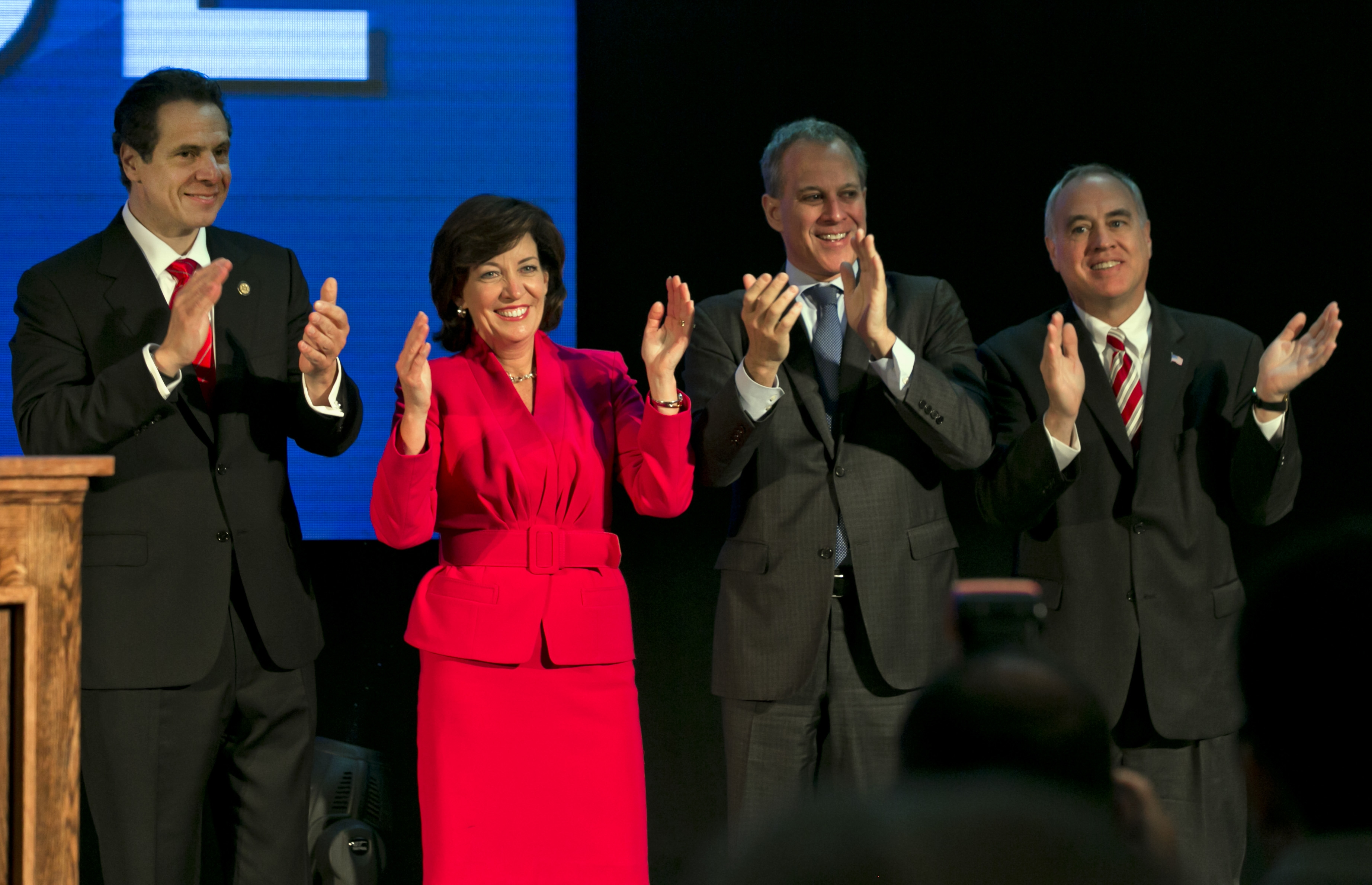 Nominees N.Y. Gov. Andrew Cuomo, his running mate, former Congresswoman Kathy Hochul, state Attorney Gen. Eric Schneiderman, and state Comptroller Thomas DiNapoli, left to right, acknowledge applause after Cuomo's speech at the state's Democratic Convention today. (AP Photo/Richard Drew)