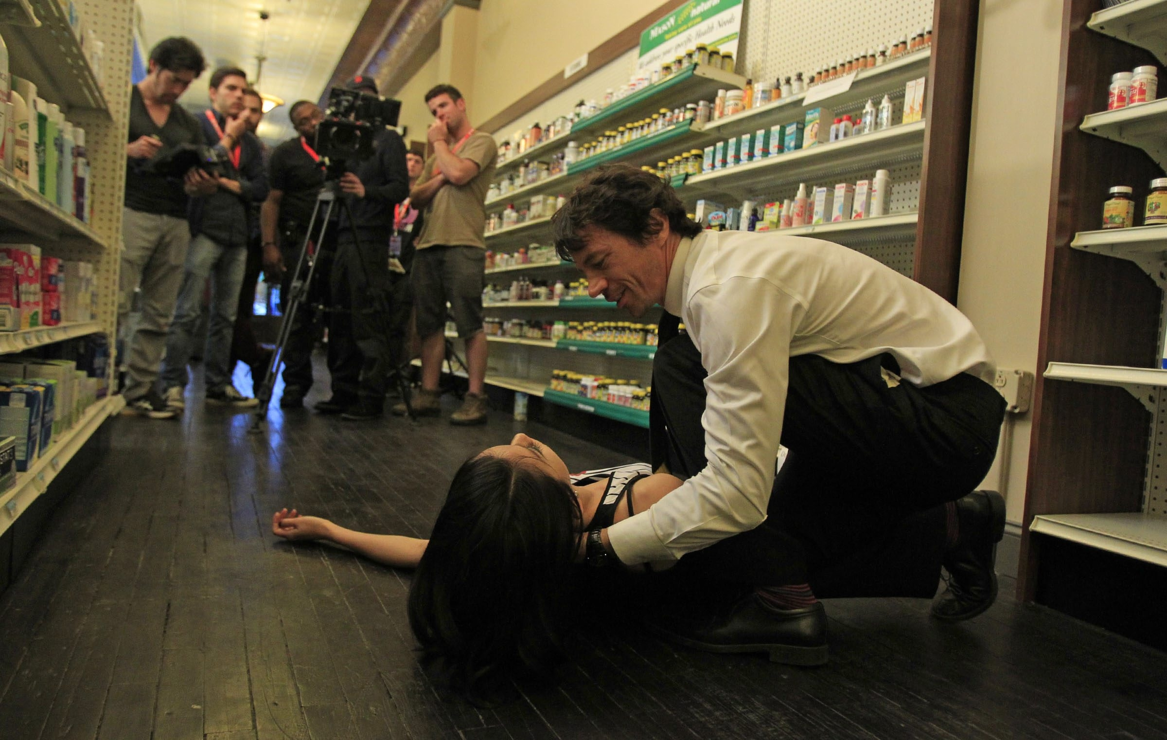 "Michael Piccirilli rehearses a scene with Pamelyn Chee during filming of the independent film ""Prescient"" at the Parker Pharmacy on Hertel Avenue Thursday."