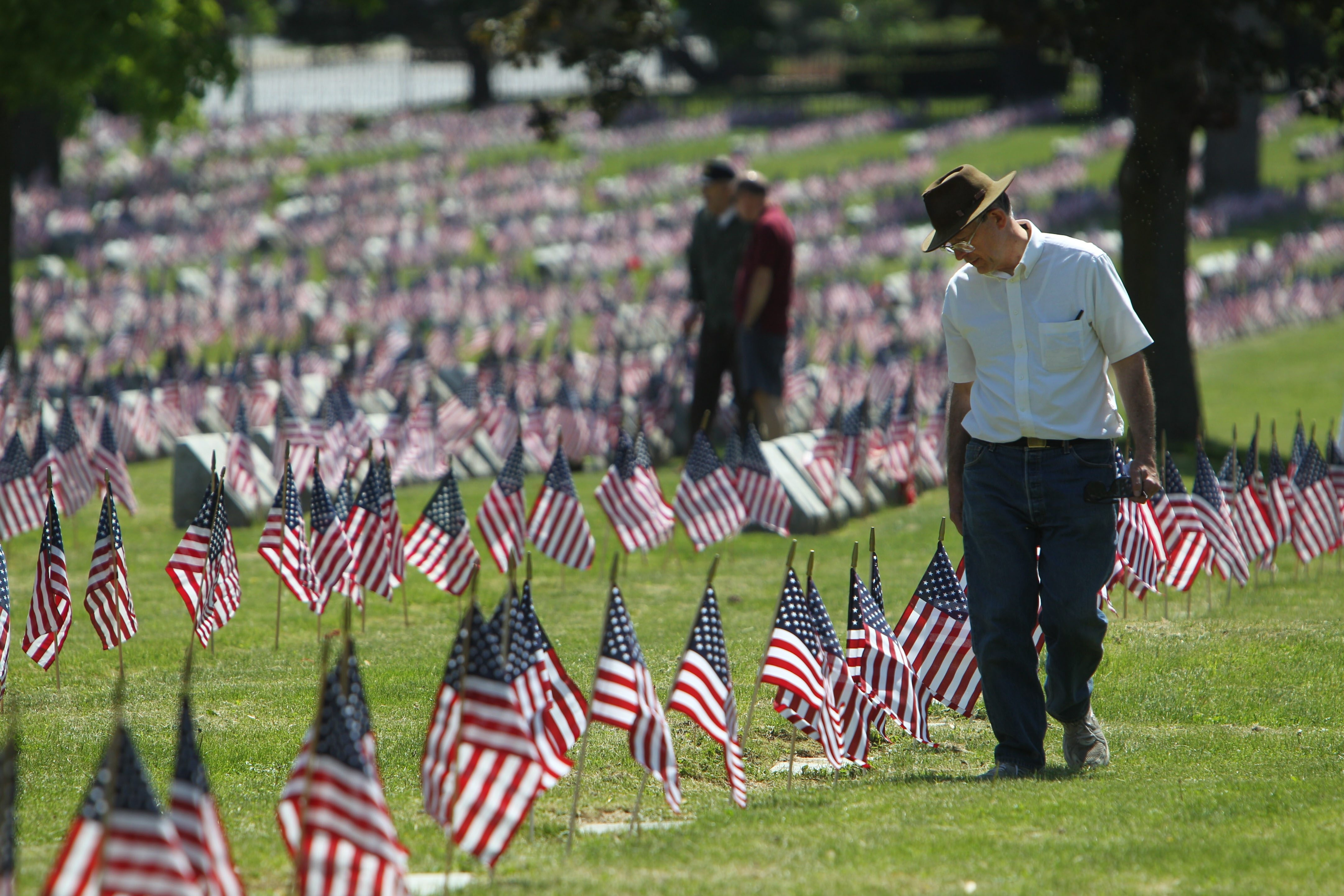 At Forest Lawn's Veterans Field, Daniel Bartoz, of Appleton, looks for the grave of his uncle, Rudalf Bartosz, who served in World War II.