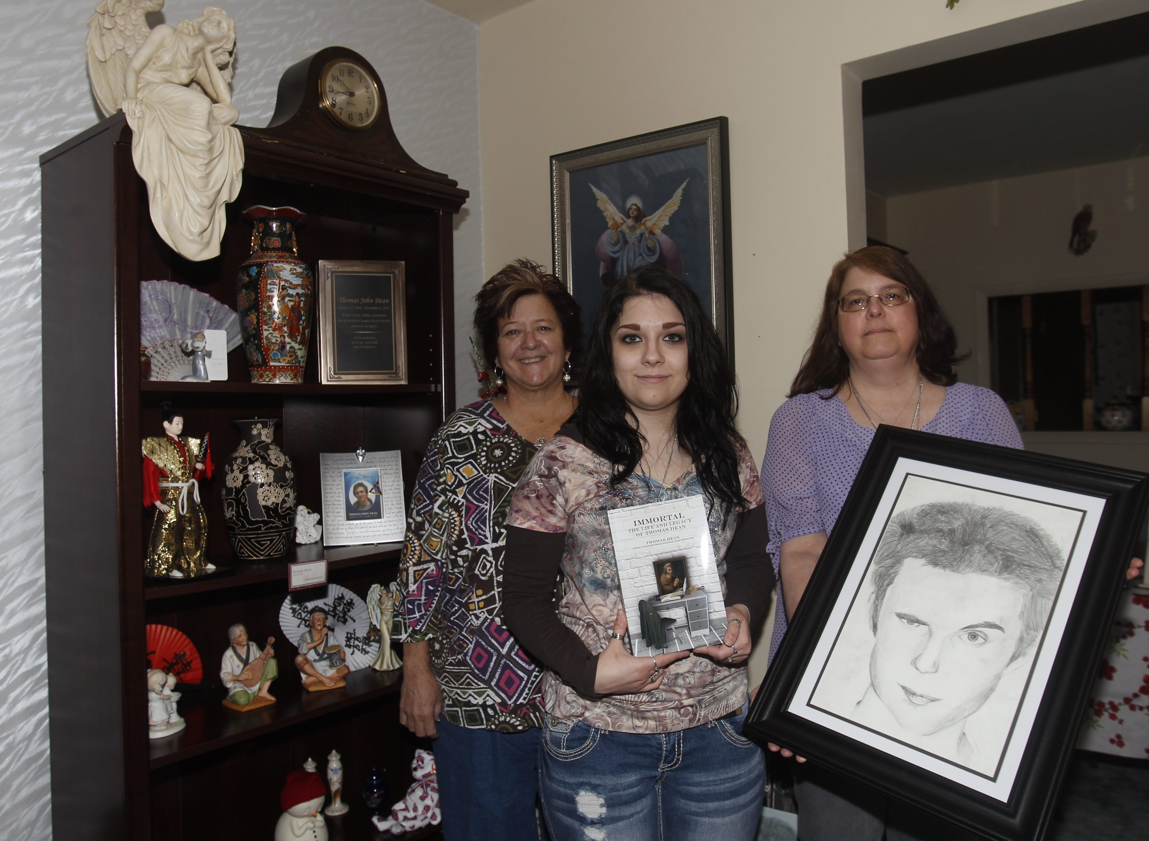 The family of Fredonia State College senior Thomas Dean, who died at school last fall of what they later learned was a virus that attacked his heart, from left,  his godmother Jean Murphy; his mother, Susan Dean;  and her daughter, Katherine.