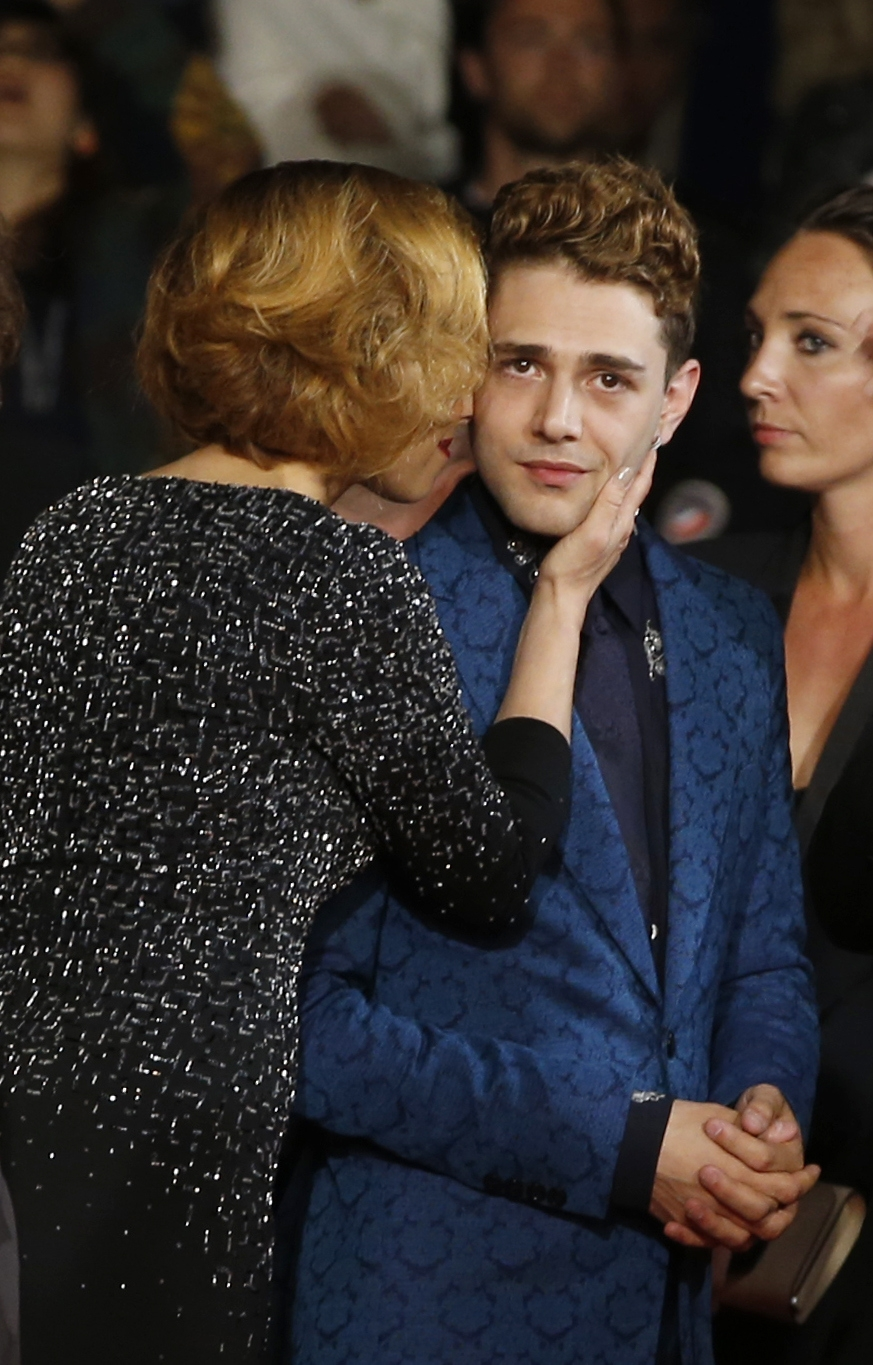 "Baby face: Actress Suzanne Clement greets director Xavier Dolan as they arrive for the screening of ""Mommy"" at the 67th international film festival in Cannes, France, on Thursday."