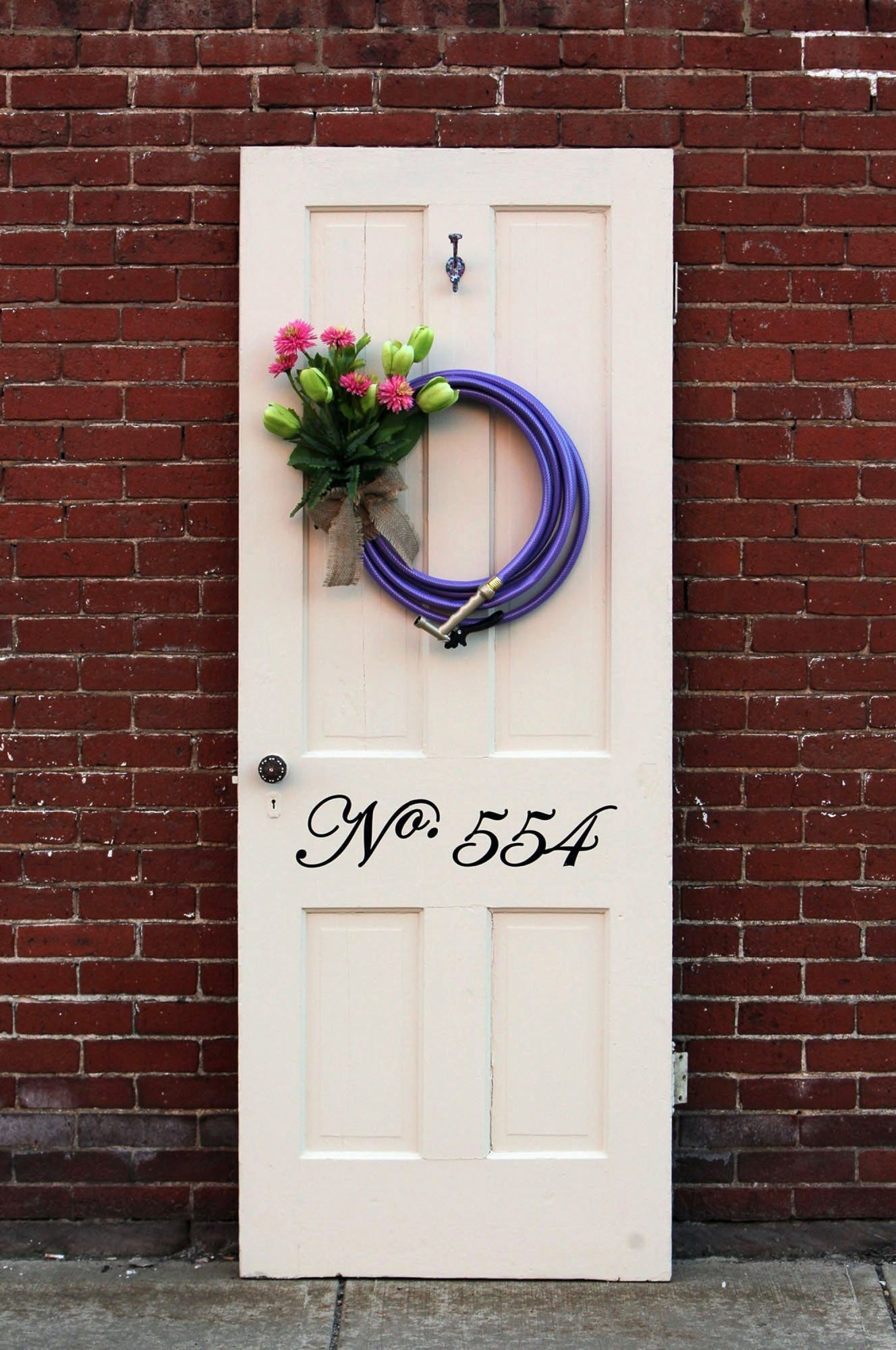 With flowers blooming in the front of houses, the front door can use a makeover to make it fresh as well. Using a few simple items found cheap at antique or design stores can do the trick. (Michael Chritton/Akron Beacon Journal/MCT)