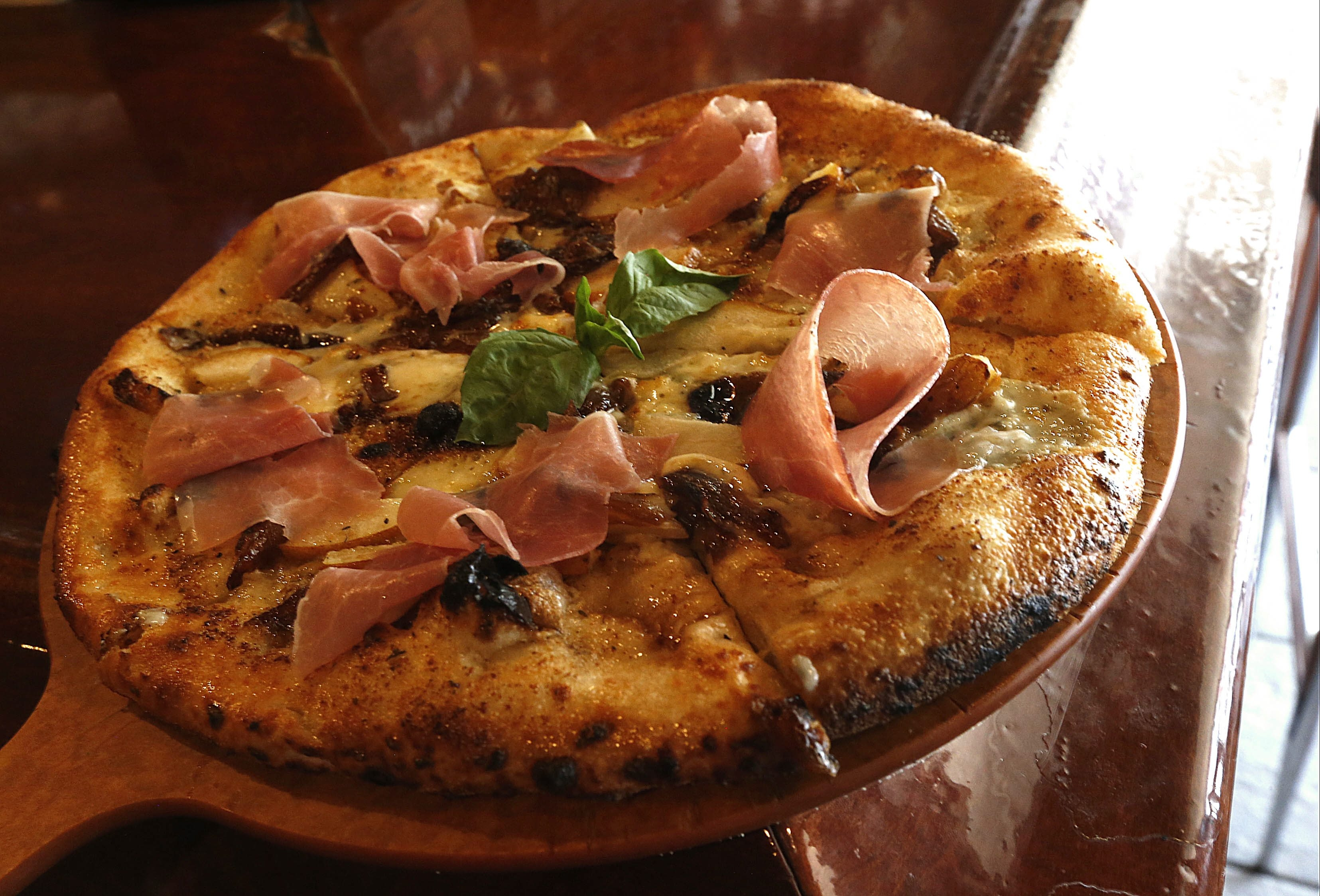 The wood fired brick oven Pear and Gorgonzola cheese pizza with light dijon butter sauce at La Tavola Trattoria on Hertel Ave. in Buffalo on  Wednesday, May 14, 2014.  (Robert Kirkham/Buffalo News)
