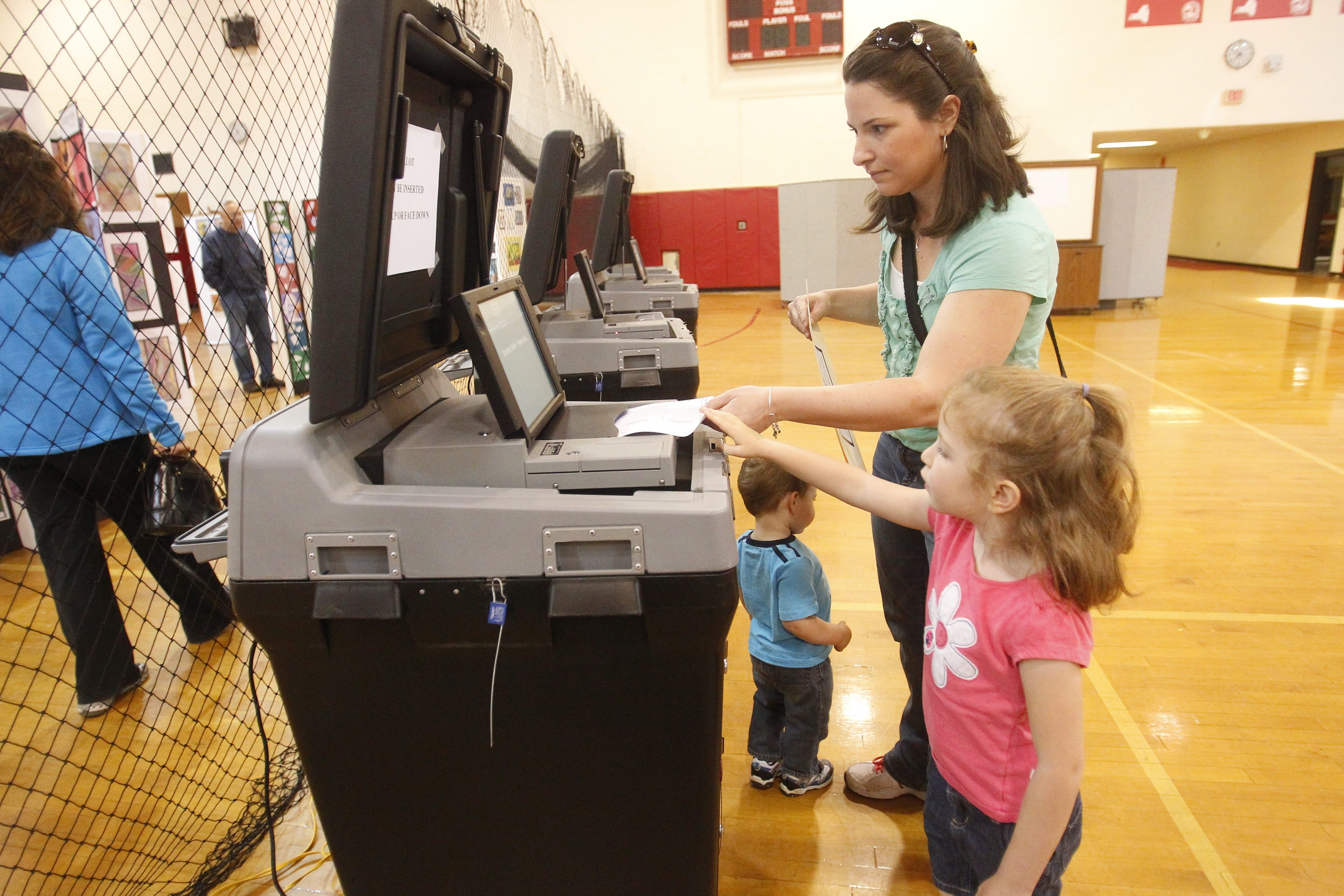 Laurie Naab goes with her children Joey, 2,  and Evie, 4,  to vote on the Clarence School budget at Clarence High School.