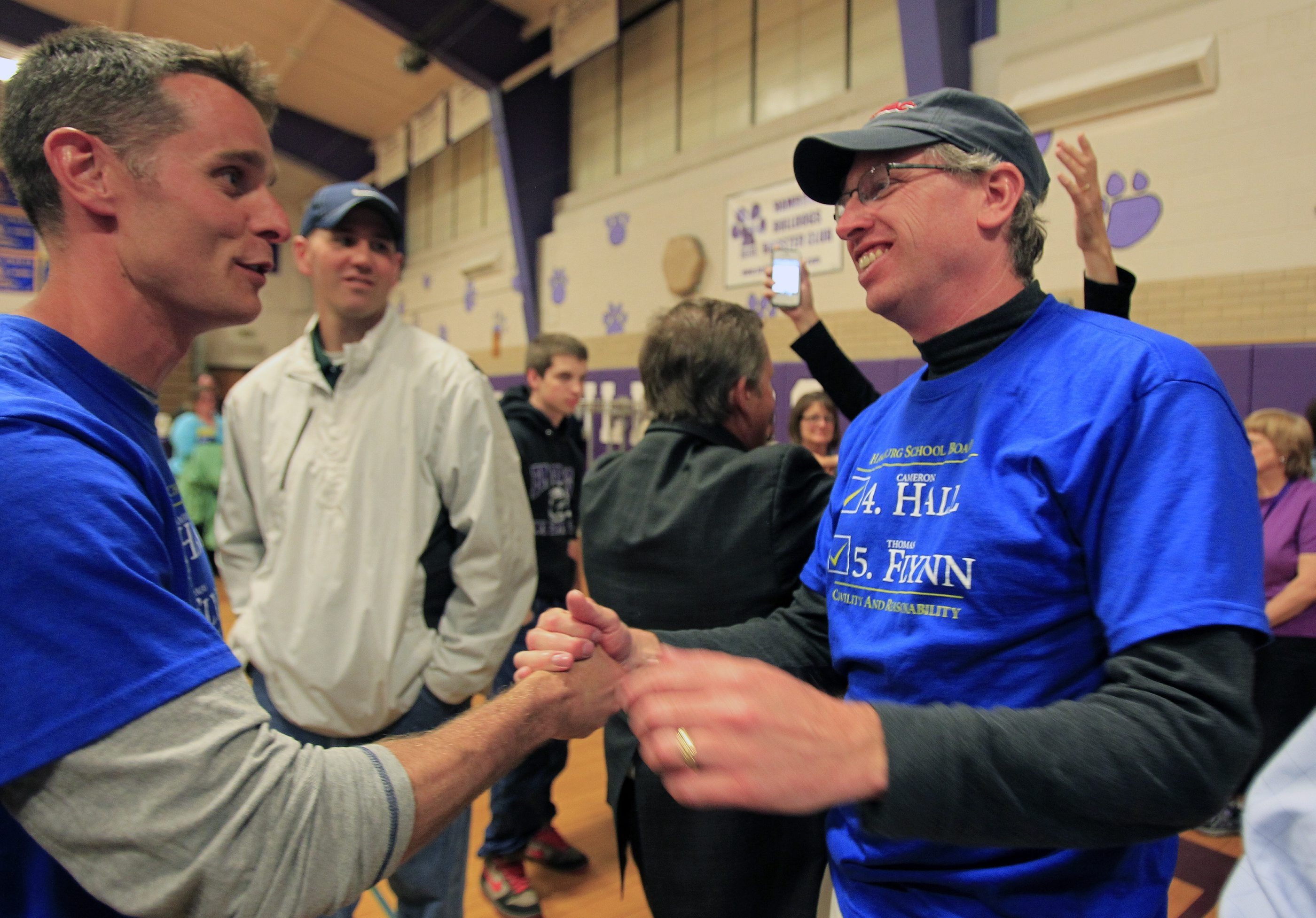 Victorious newcomer Cameron Hall, left, congratulates incumbent Hamburg School Board member Thomas Flynn on his reelection to the board. The two ran together and were backed by Hamburg attorney and parent Daniel J. Chiacchia. (Photo by Harry Scull Jr. /Buffalo News)