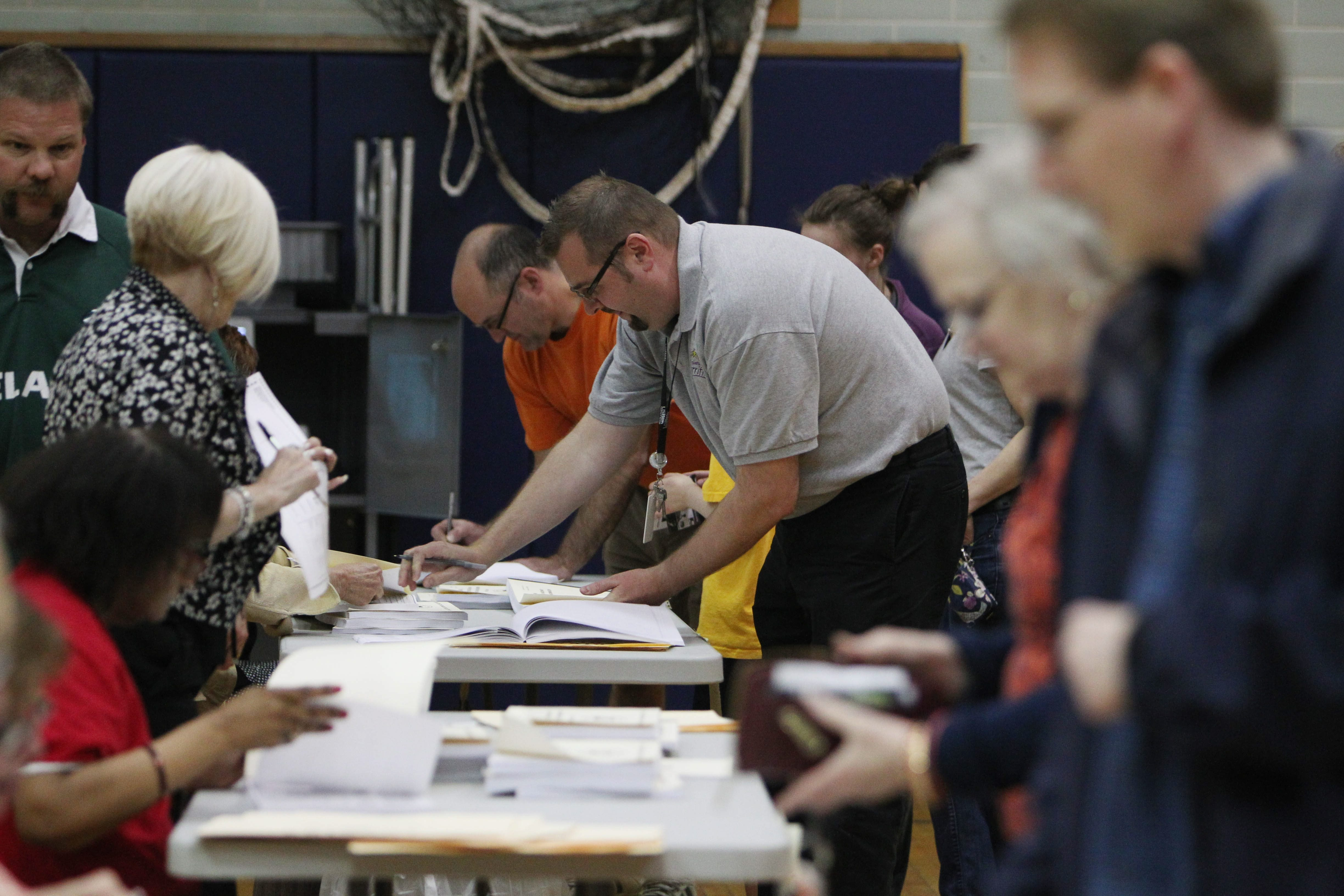 Residents in the Ken-Ton School District vote at Hoover Middle School.