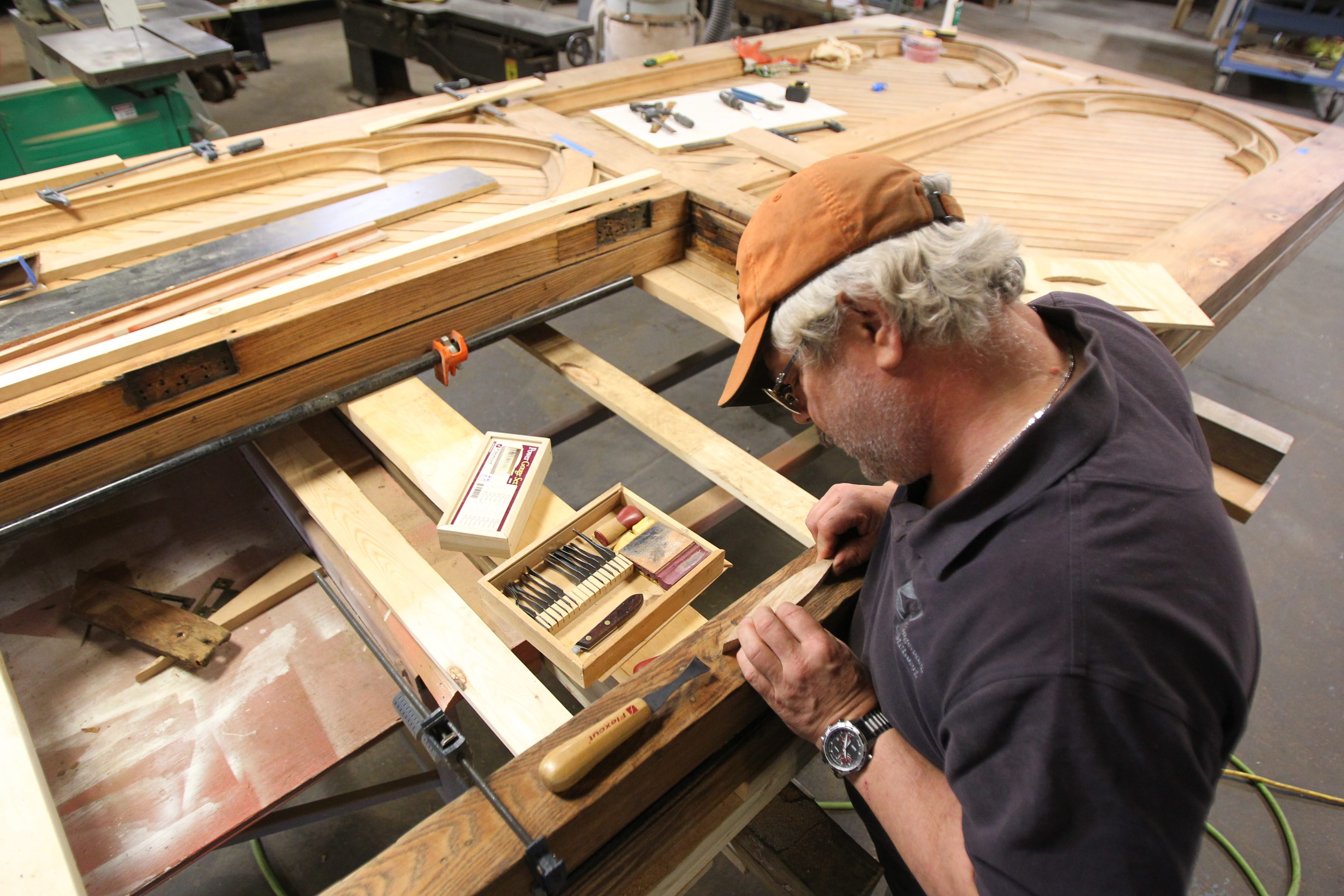 Kingswood master wood worker Barry Casement works with a replacement peice as he works to restore doors from St. Patrick Cathedral in New York at their workshop in Buffalo Tuesday, April 29, 2014.  (Mark Mulville/Buffalo News)