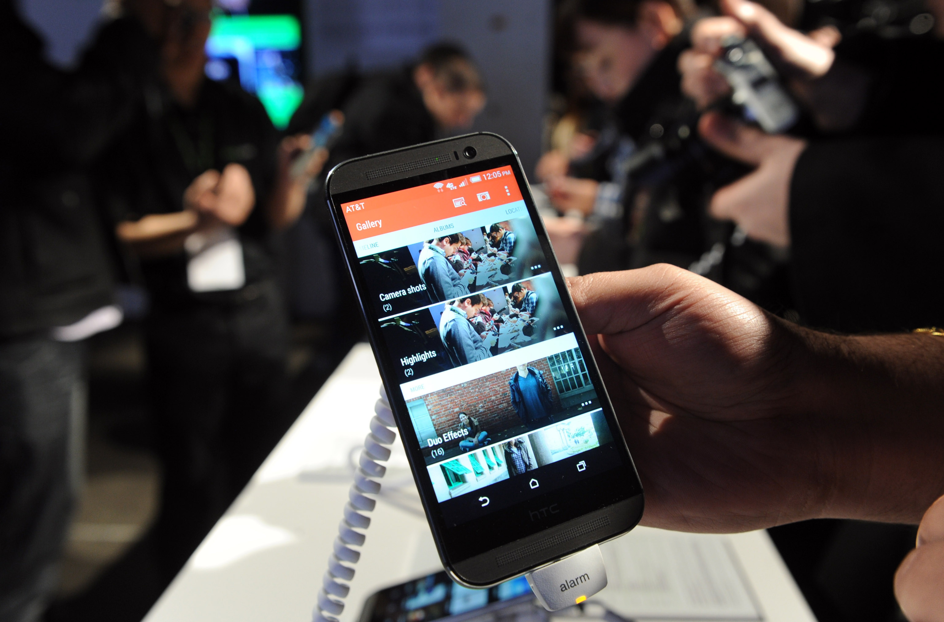 Talk in the tech world points to Apple catching up to other companies when it comes to big-screen smartphones, like the HTC One (M8) shown here.