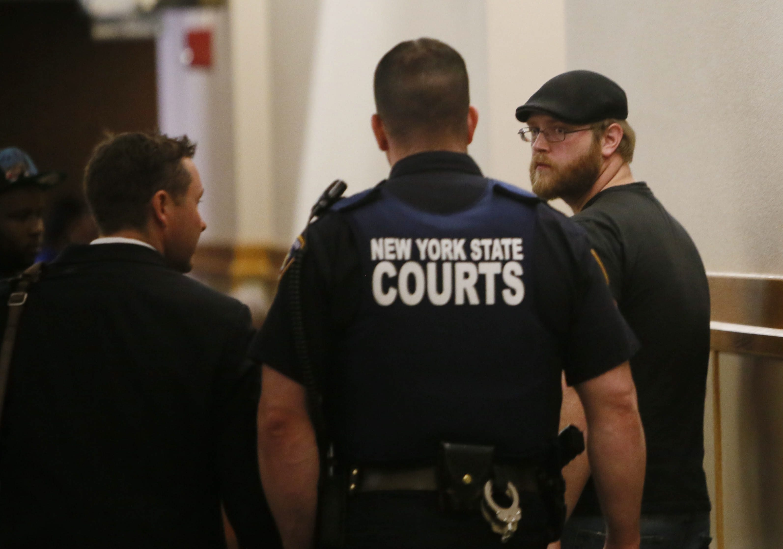 Donald Hall, right, who was arrested for trespassing while trying to get help for his friend who was nearly beaten to death at Molly's Pub, leaves Buffalo City Court with attorney Thomas P. Hurley, left, after the charges were dismissed today.