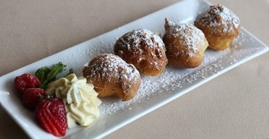Sfinge Di San Guiseppe with ricotta filling is a favorite at Gigi's Cucina Povera on Kenmore Ave. Wednesday, May 7, 2014.  (Sharon Cantillon/Buffalo News)
