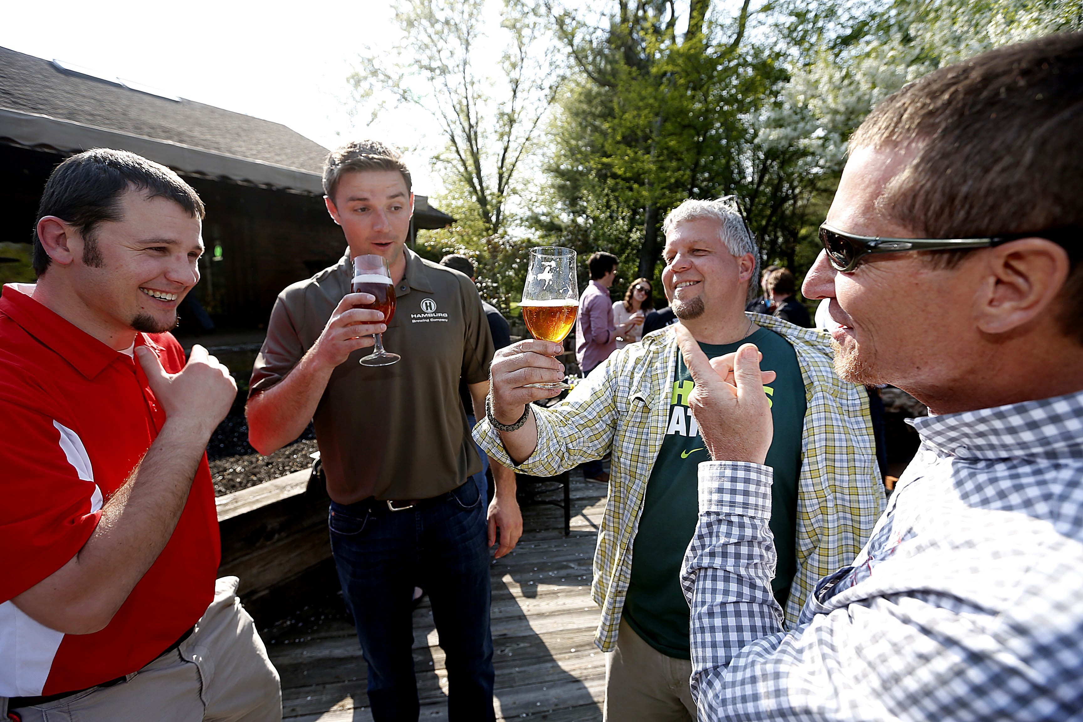 """At """"Farm to Pint"""" event are, from left, Bill Verbeten, of Cornell Extension, brewer John Russo, hop farmer Gary Kwiatkowski and maltster Ted Hawley."""