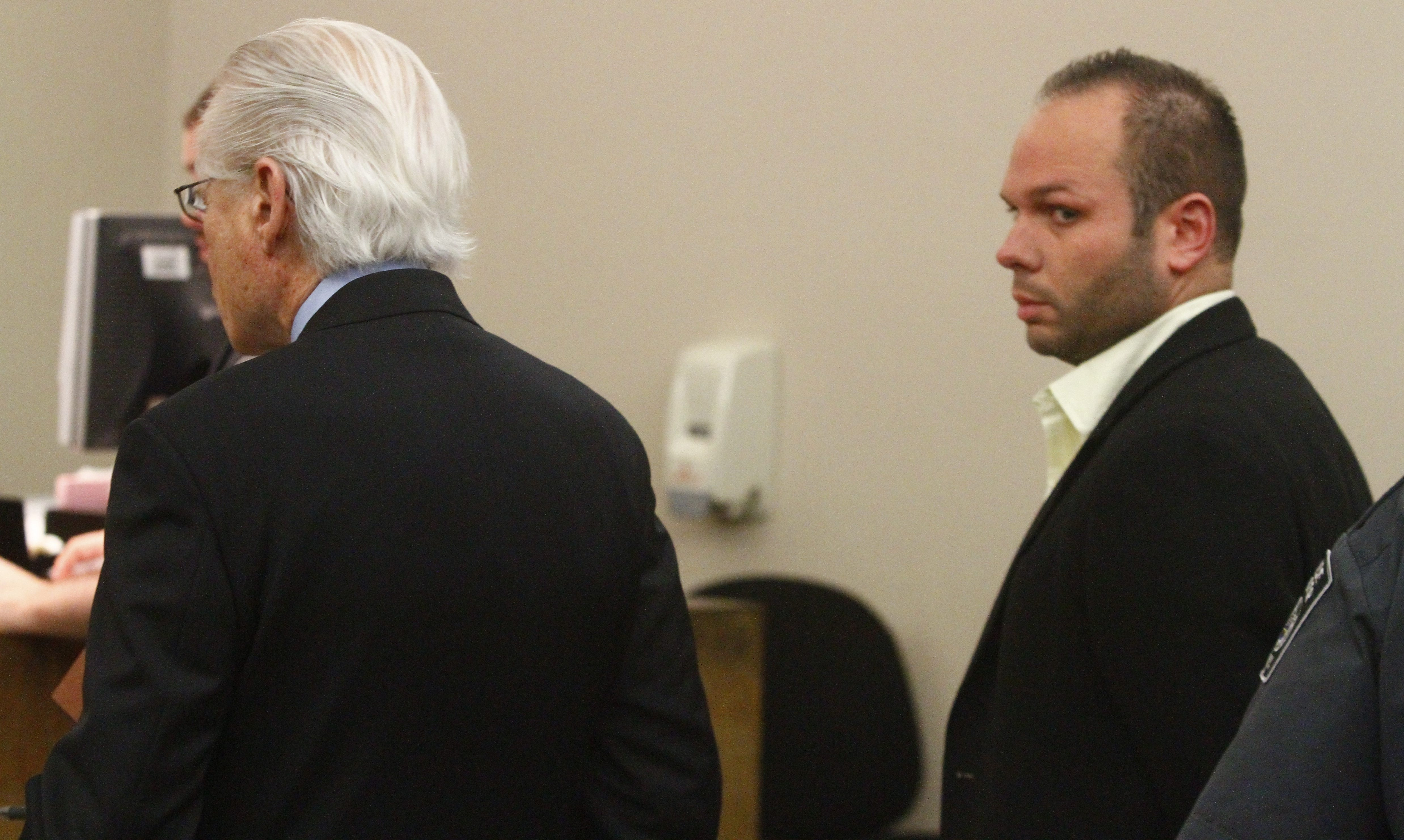 Arraigned in City Court, Molly's Pub manager Jeffrey J. Basil pleads not guilty to first-degree assault in May 11 incident at bar on Main Street.