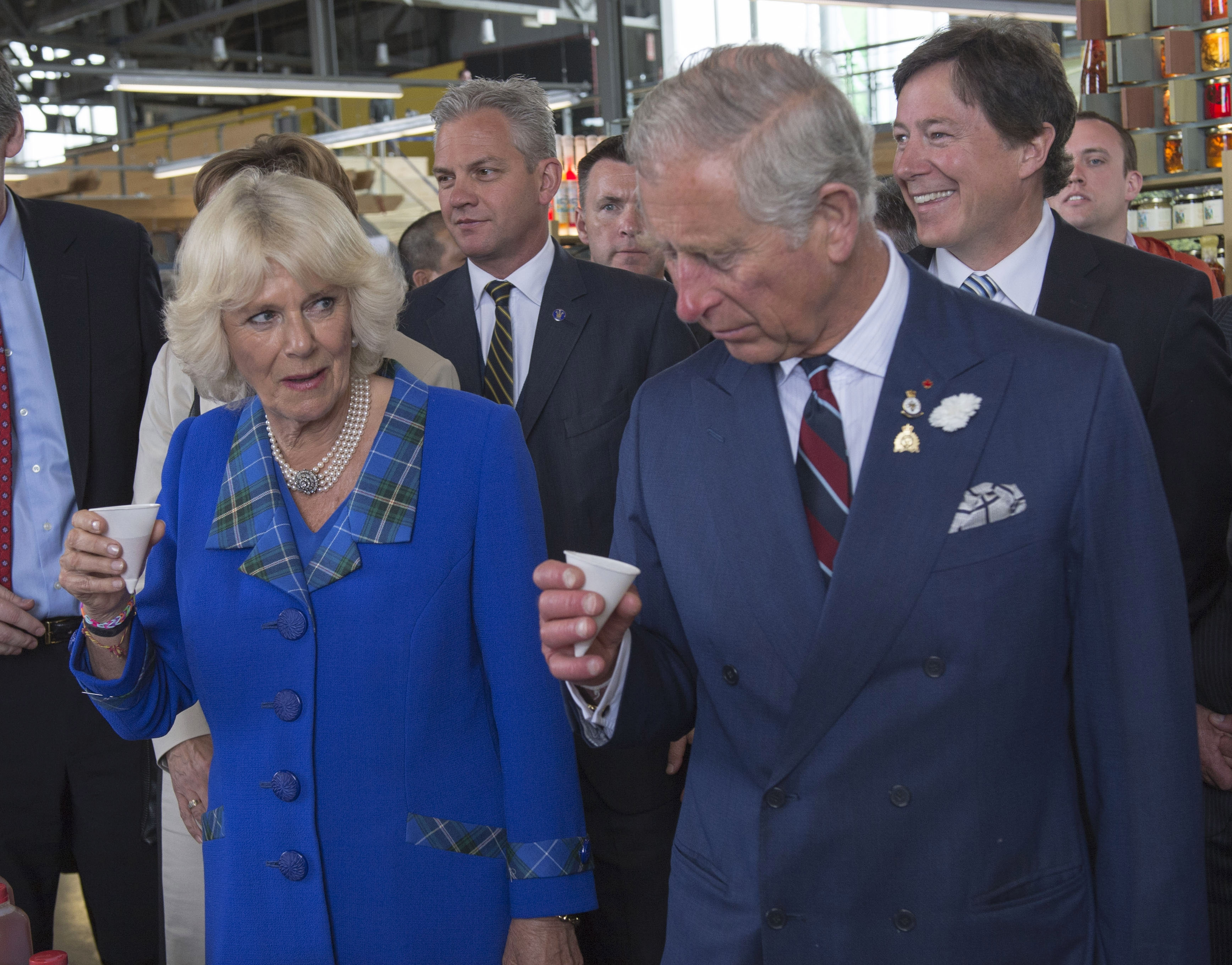 People of taste: Camilla, Duchess of Cornwall, and Prince Charles, Prince of Wales, sample some food at Seaport Farmer's Market in Halifax, Nova Scotia, Monday.