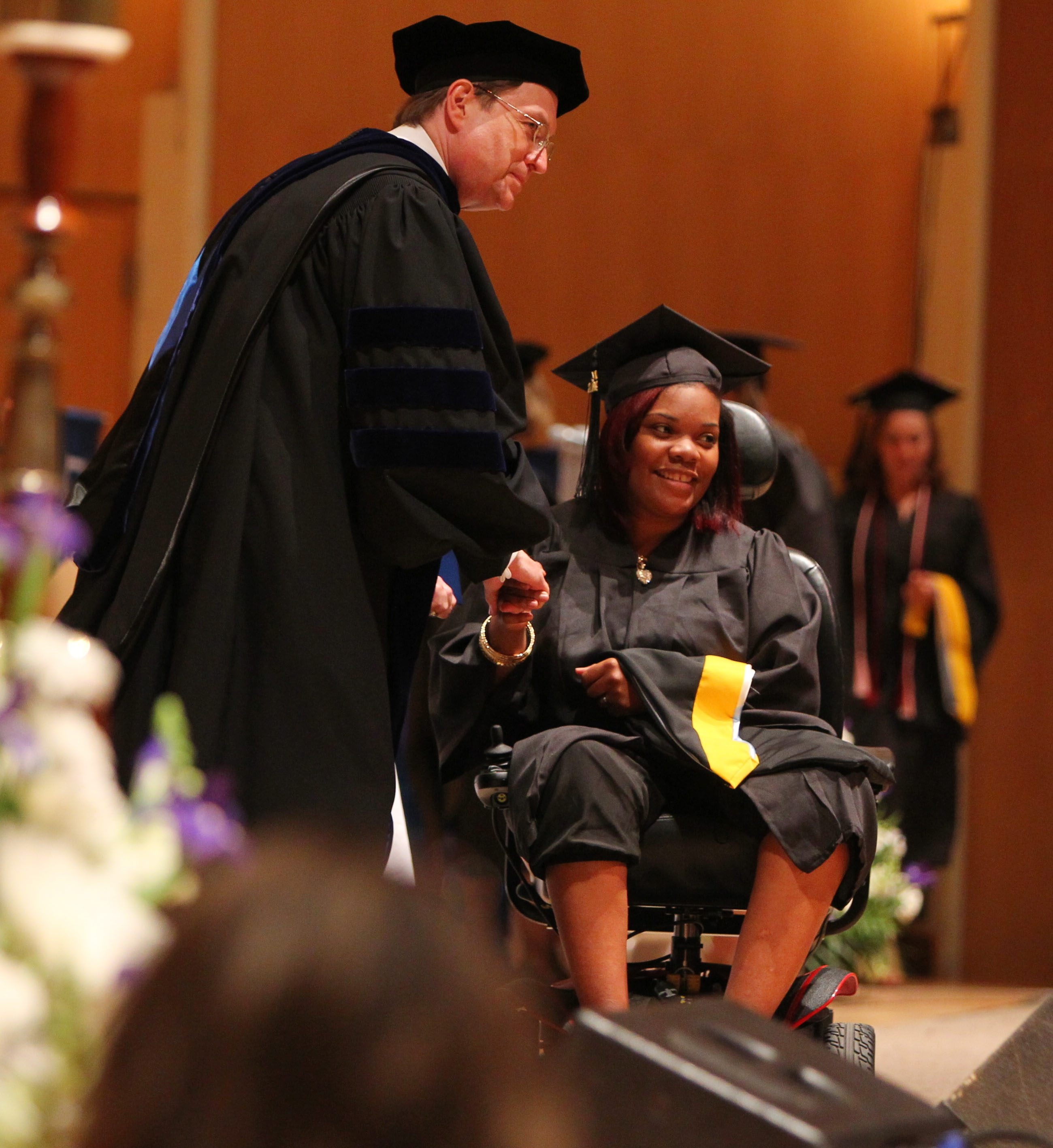 La'Quisha Pompey receives her diploma from college President Gary A. Olson during Daemen College's commencement ceremonies Saturday in Kleinhans Music Hall.