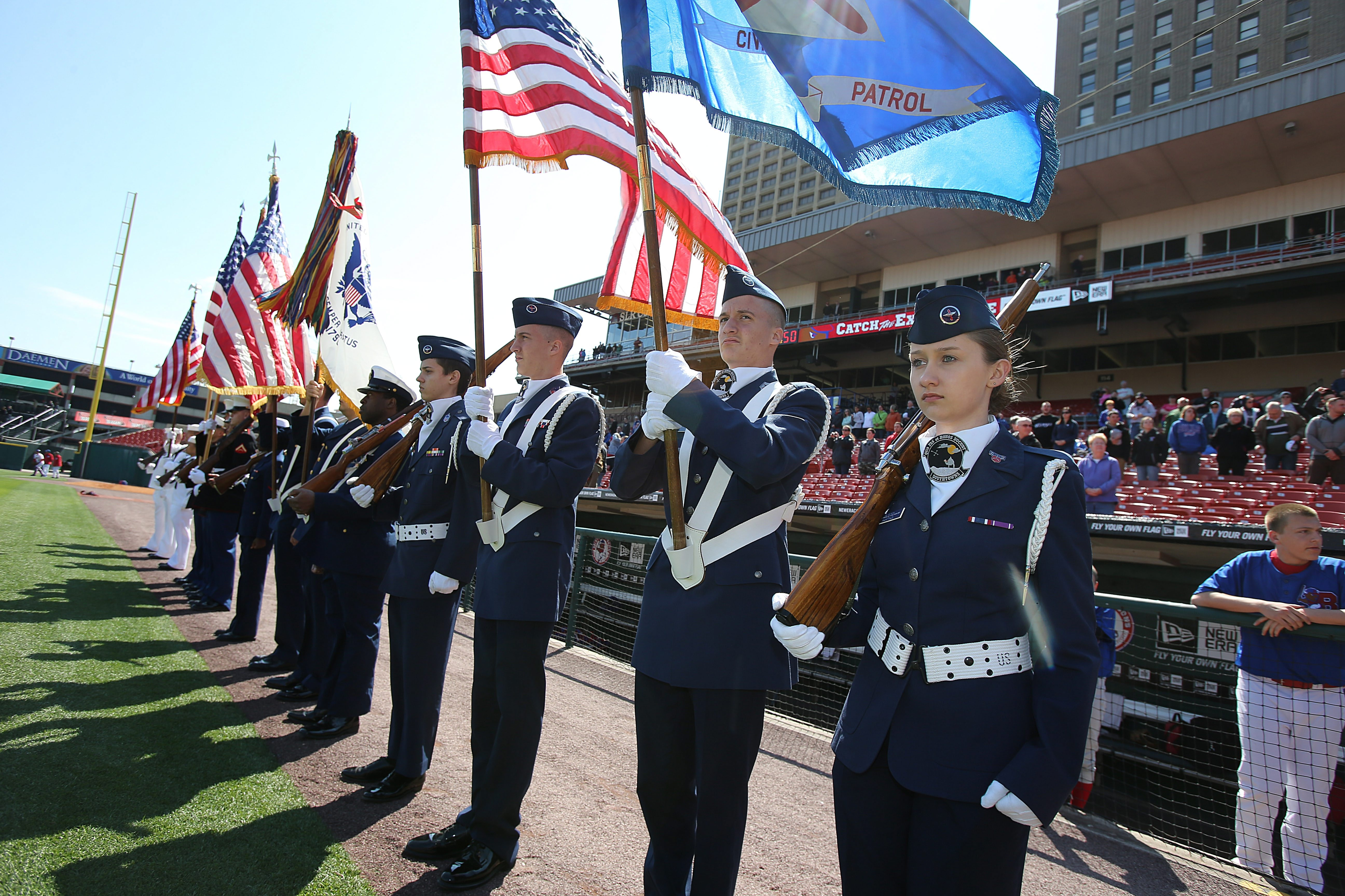 Color Guard members stand in formation prior to first pitch during Armed Forces Tribute Day at Coca Cola Field.