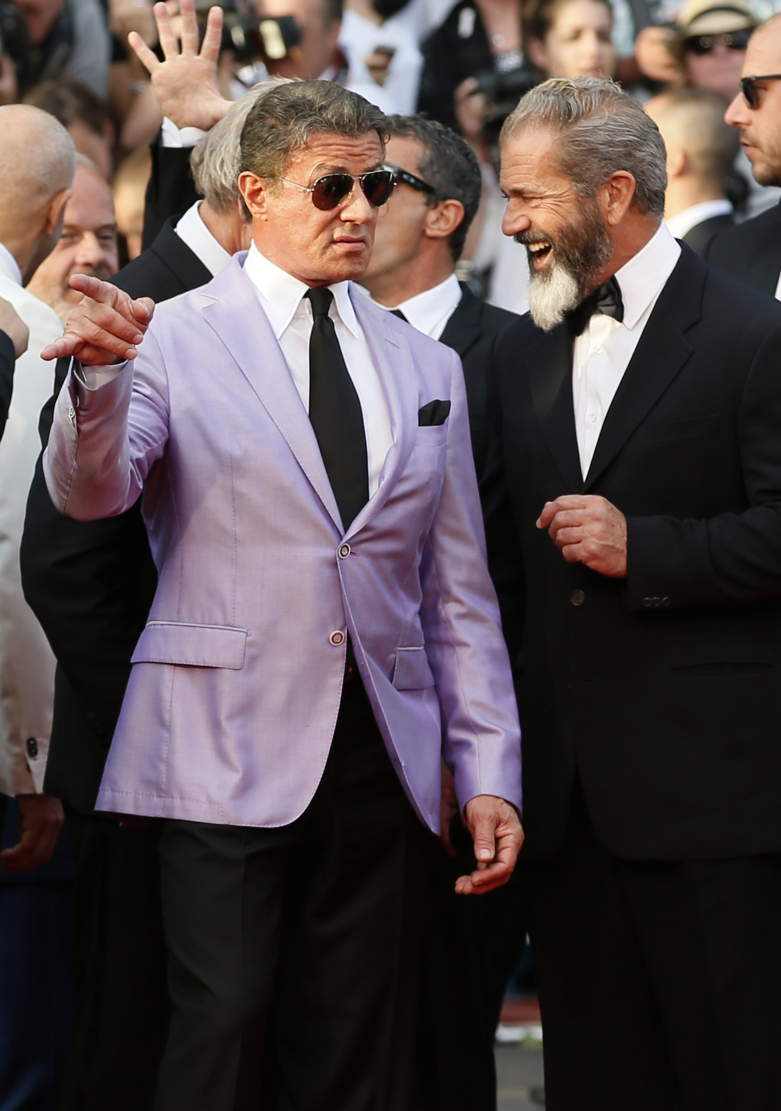 Yo, how you doin'?: Actors Sylvester Stallone and Mel Gibson were part of the crowd Sunday as they arrived at the 67th international film festival in Cannes, France.