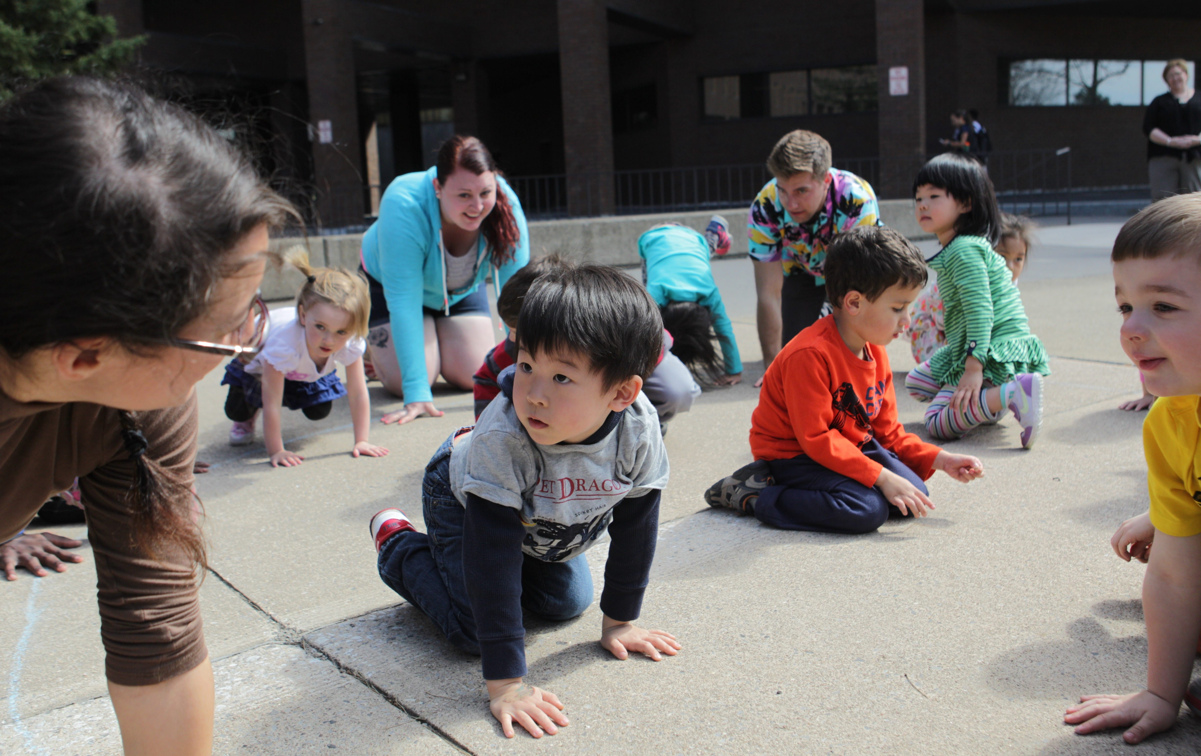 PhD student Alexia Buono, left,  leads the pre school children in a yoga class at the UB Graduate School of Education's Early Childhood Research Center, Monday, April 21, 2014 as part of their exercise program.  In center is Joshua Yoo, 4.   (Sharon Cantillon/Buffalo News)