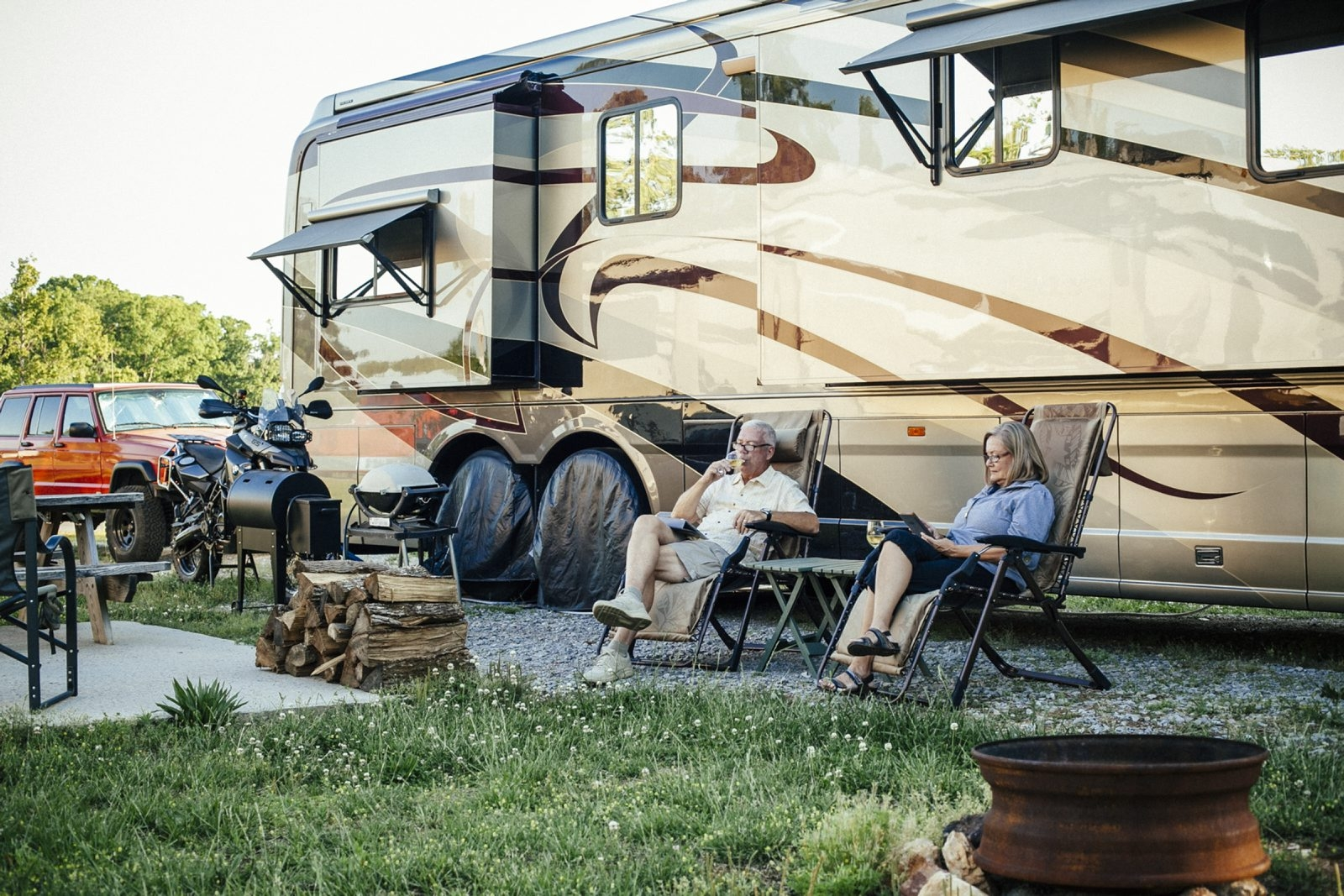 Jim and Jaylene Myers are shown with their 45-foot rolling home at Lazy Acres RV Park in Lenoir City, Tenn. The Myerses are members of a high-octane tribe of retirees who are transforming their golden years into a golden age of adventure on the open road.