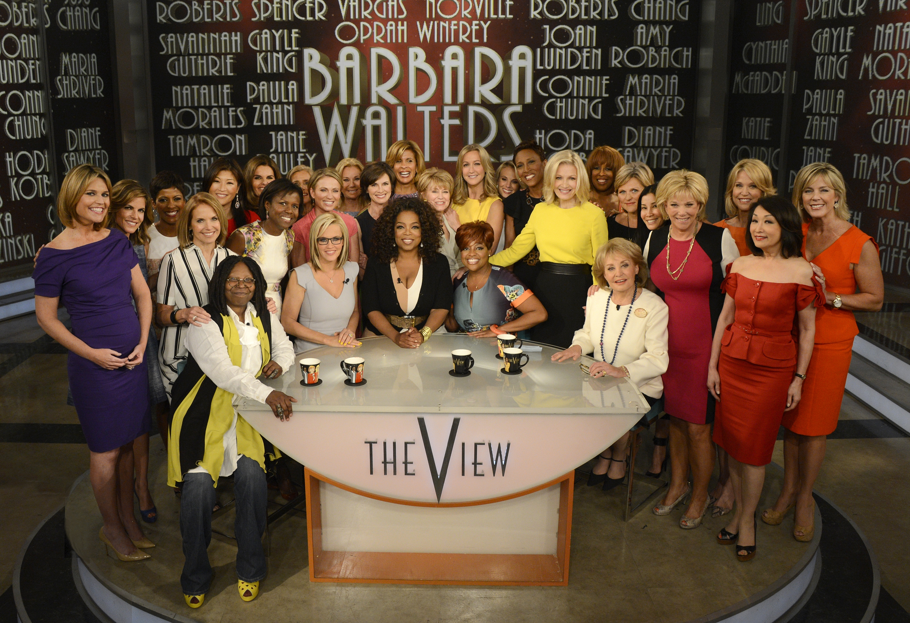 "Seated, from left at table, are Whoopi Goldberg, Jenny McCarthy, Oprah Winfrey, Sherri Shepherd and Barbara Walters. Fellow female broadcasters stopped by for Thursday's taping of Walters' final co-host appearance on ""The View."""