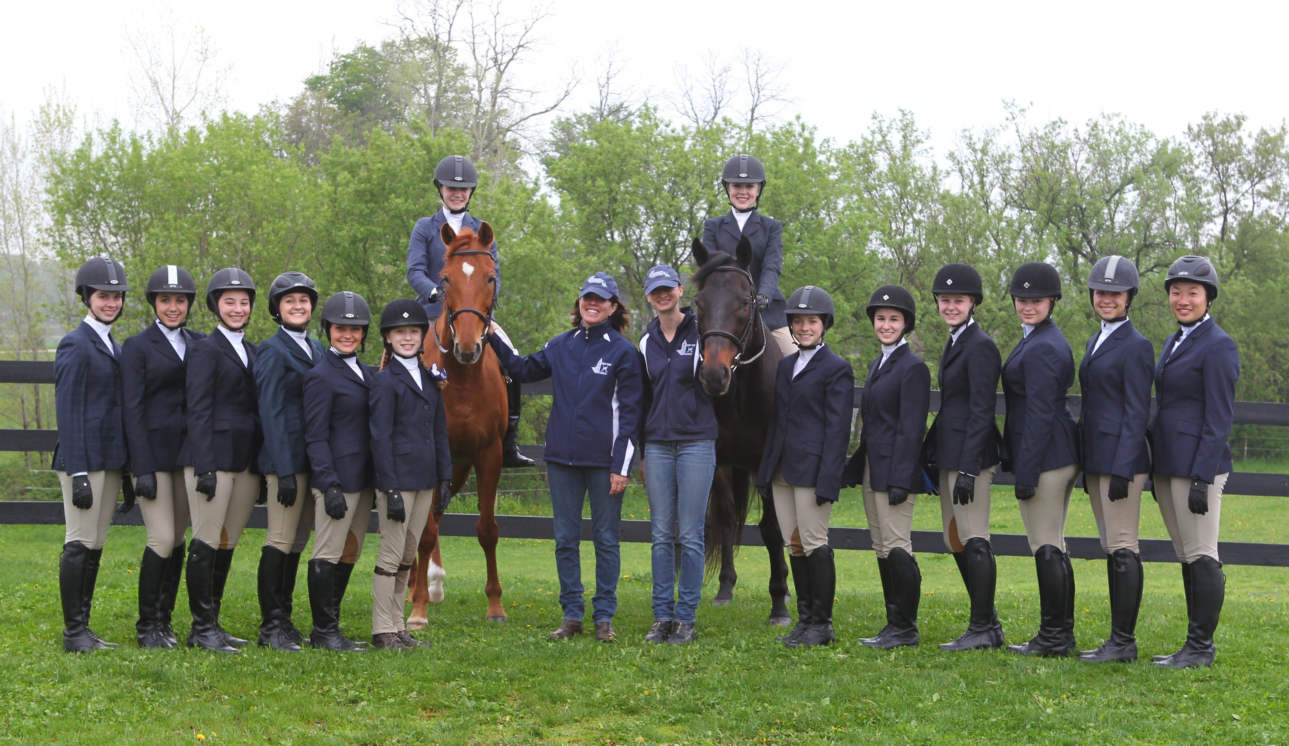 Members of the High Time Stables team, standing at Sugar Brook Farm in East Aurora, are, from left: Fiona Nocera, Miranda Alessi, Rachel Kempf, Aubrie Gluszak, Jamie Thuman, Sophia Azurin, Sarah Klocke, coach Leigh Fischer, assistant coach Barb Koziol, Lissy Naber, Karli Morrill, Theresa Cometto, Emily Kerl, Rachael Surowiec, Katelyn Cefali and Megan He.    , at the farm in East Aurora Wednesday, May 14, 2014.  (Mark Mulville/Buffalo News)
