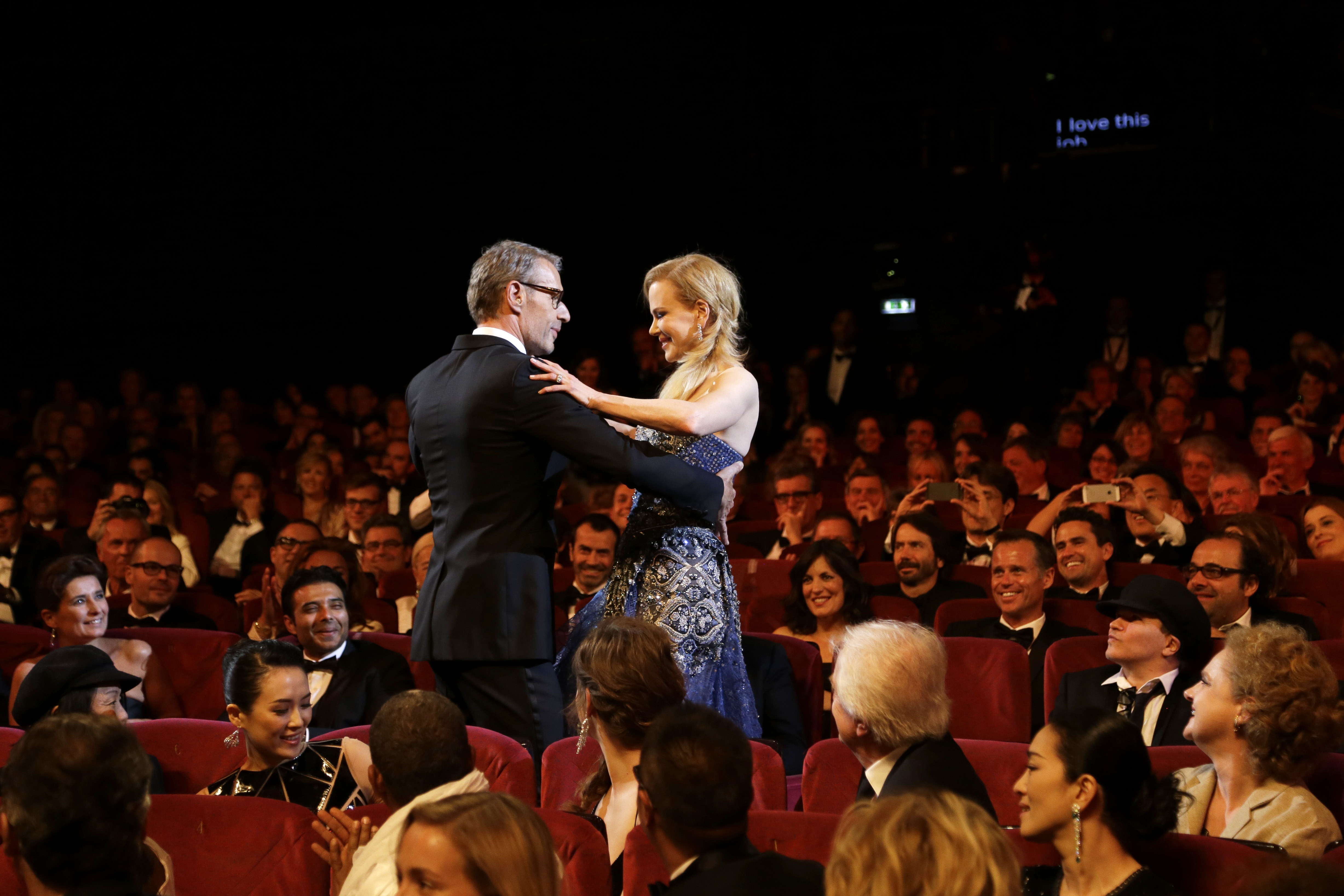 Can I have this dance?: Actress Nicole Kidman and master of ceremonies Lambert Wilson take a turn during the opening ceremony of the Cannes Film Festival in France  on Wednesday.