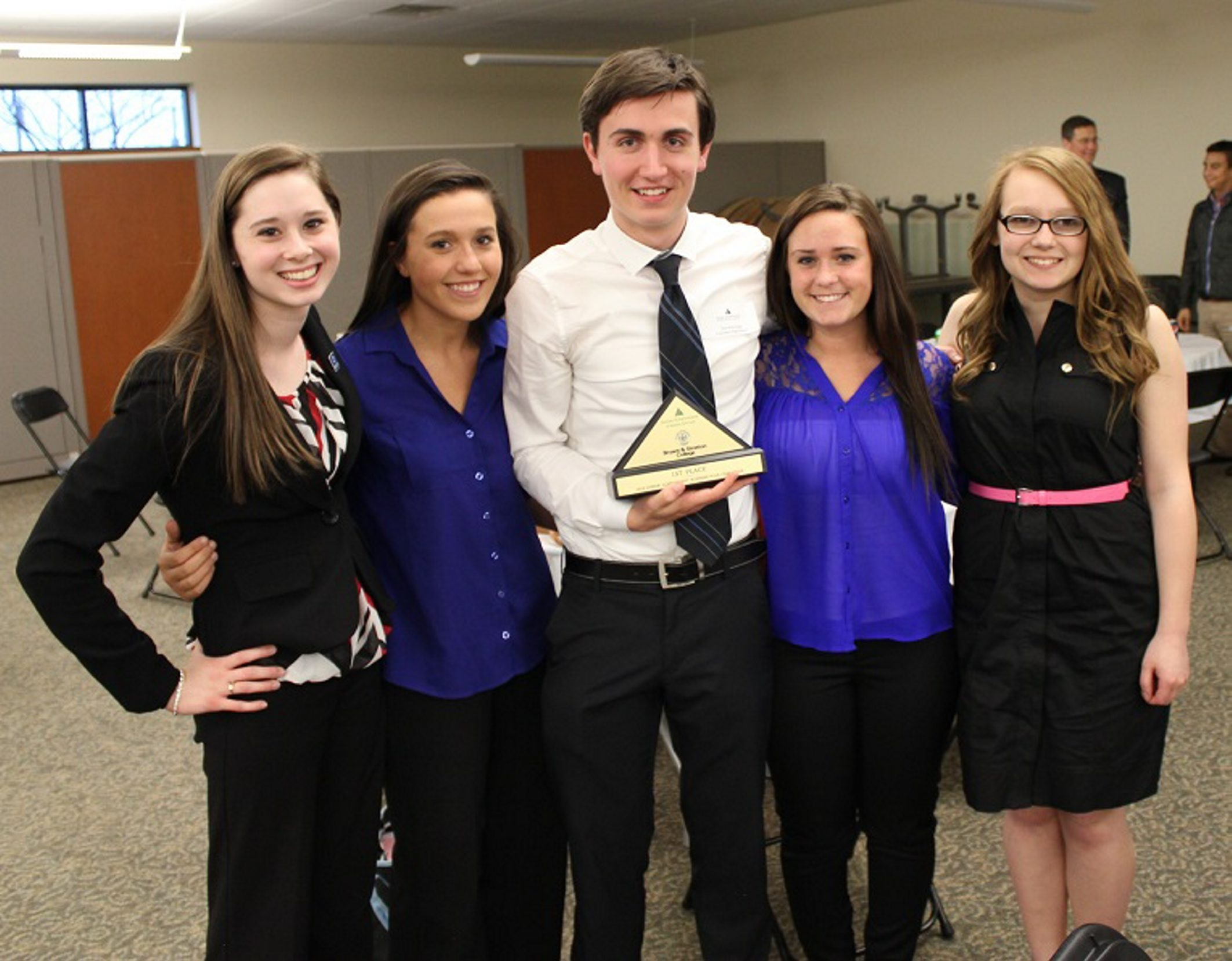 The winner of the Junior Achievement Business Plan Challenge, Nathan Riexinger, of Lancaster High School, is pictured at left with Sarah Collins, Sarah Johnson, Kaylie Bauer and Angelic Burg, all of Lancaster High School. In center photo is Danielle Arnold and Megan Krebs, of Pembroke High School. And, at right, is Grace Herman, of Lockport High School.