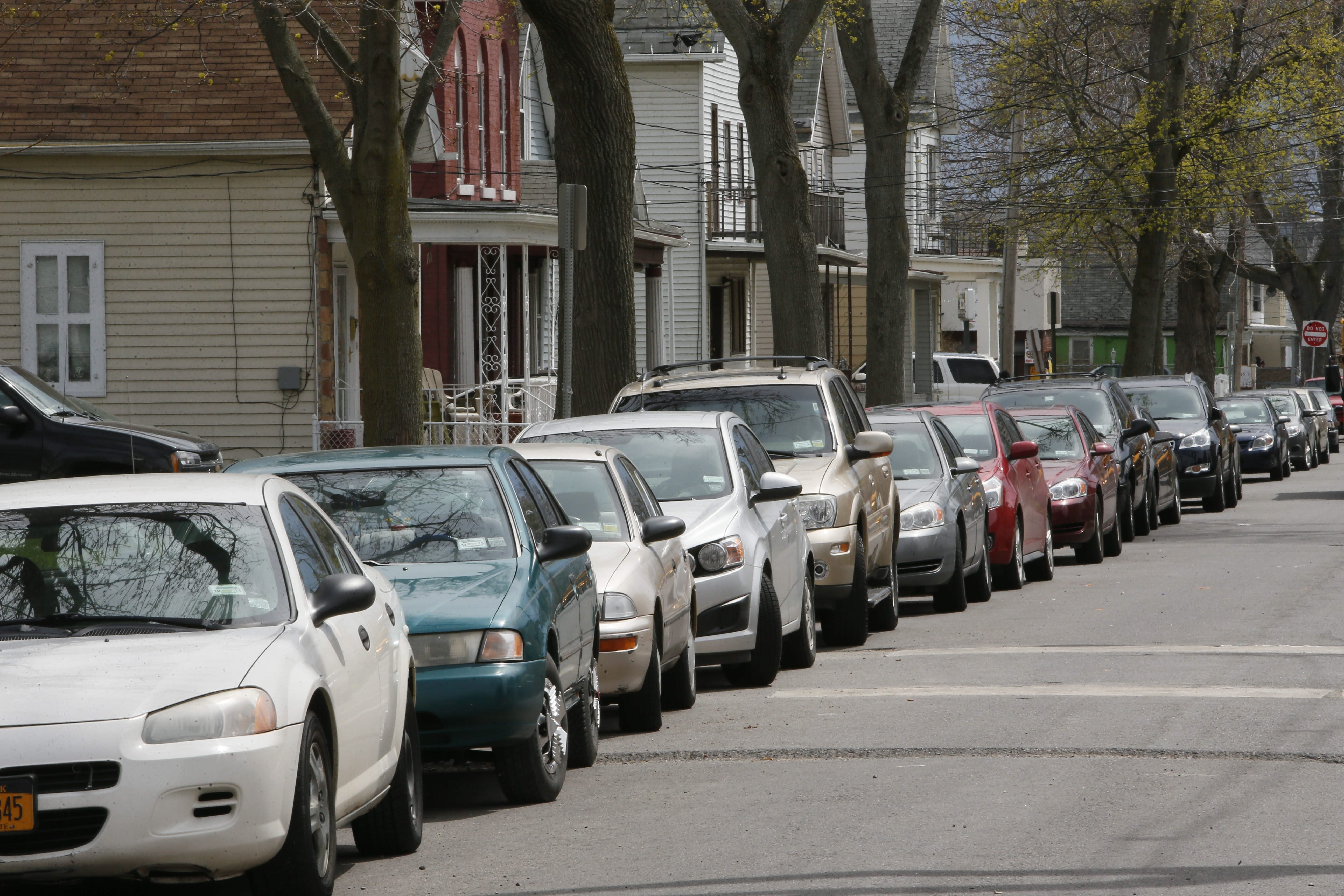 Cars are parked bumper to bumper on Maple Street in the Fruit Belt as the street has become a popular parking spot workers at the Buffalo Niagara Medical Campus.  (Derek Gee/Buffalo News)