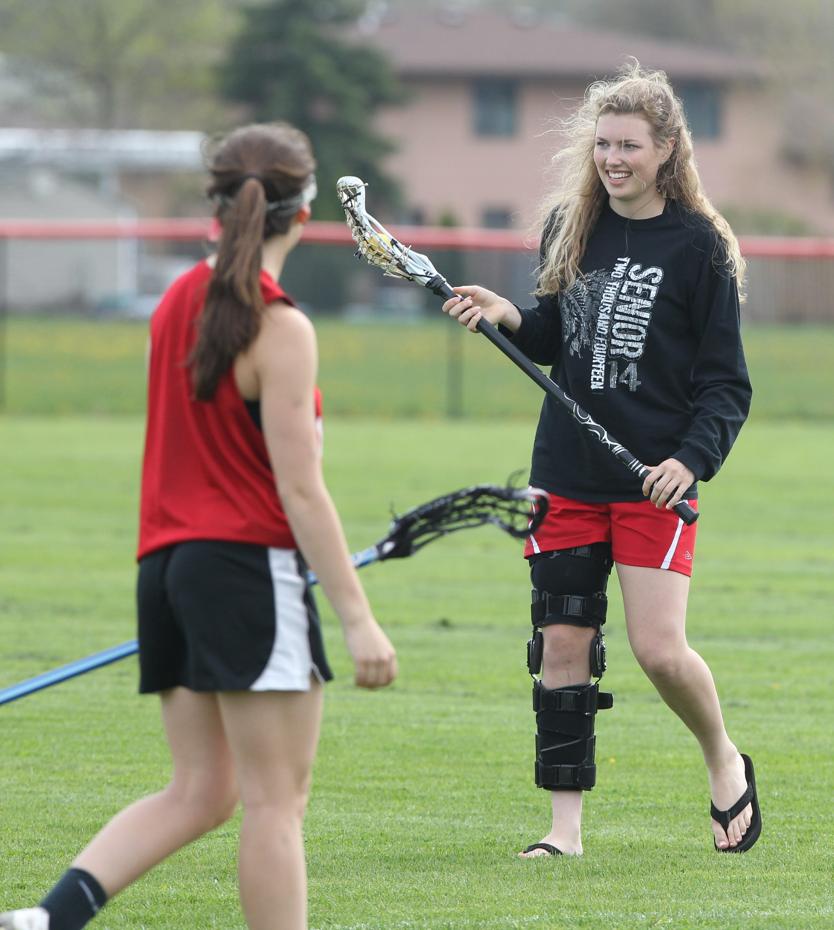 Senior Rachel Heidenreich is doing her best to contribute to Lancaster's on-field success as an assistant while being sidelined by a knee injury.