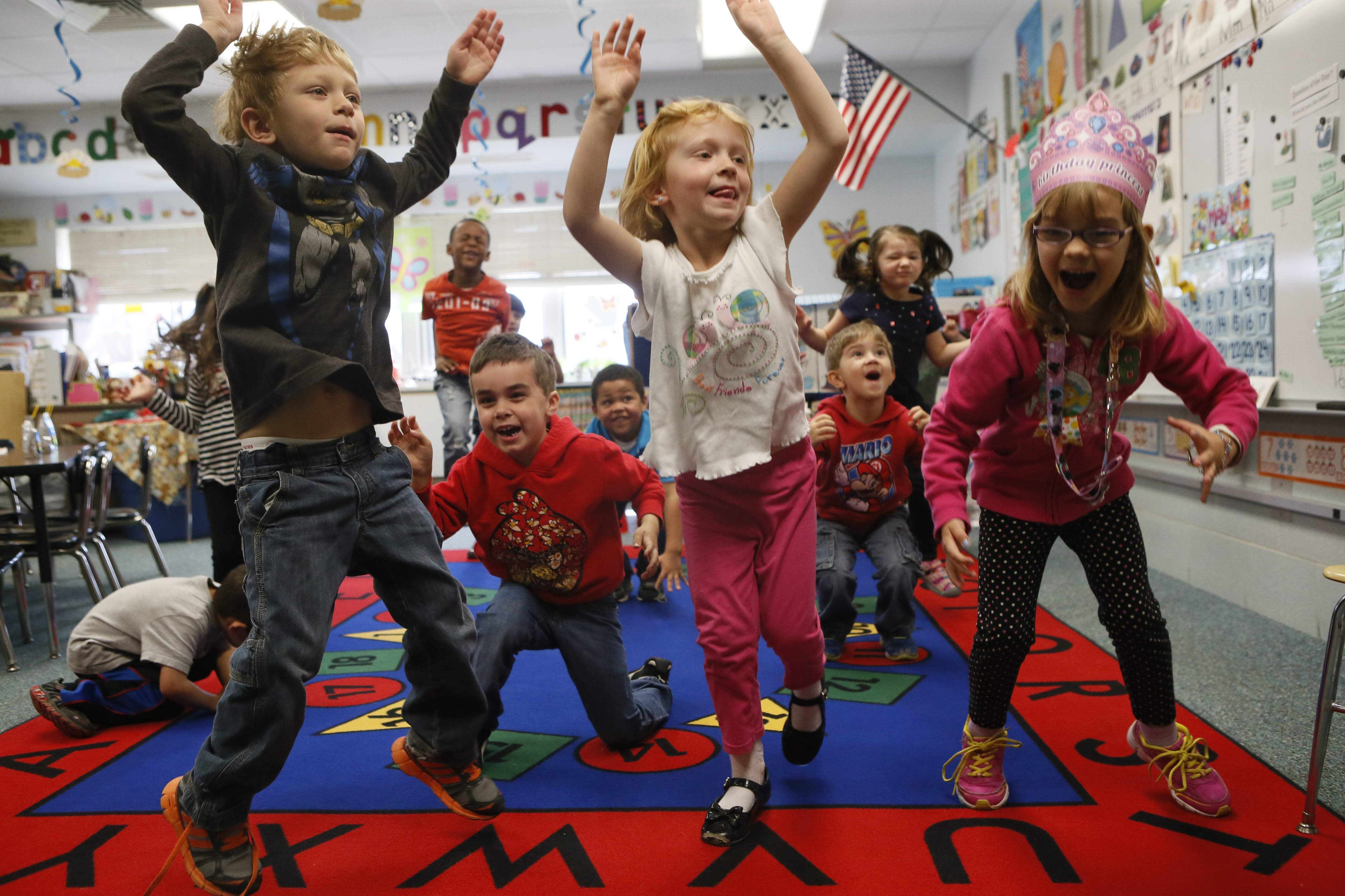 Students in the pre-K program at Willow Ridge Elementary School, part of Sweet Home Central Schools, jump up in the air like popcorn kernels during a dance activity.