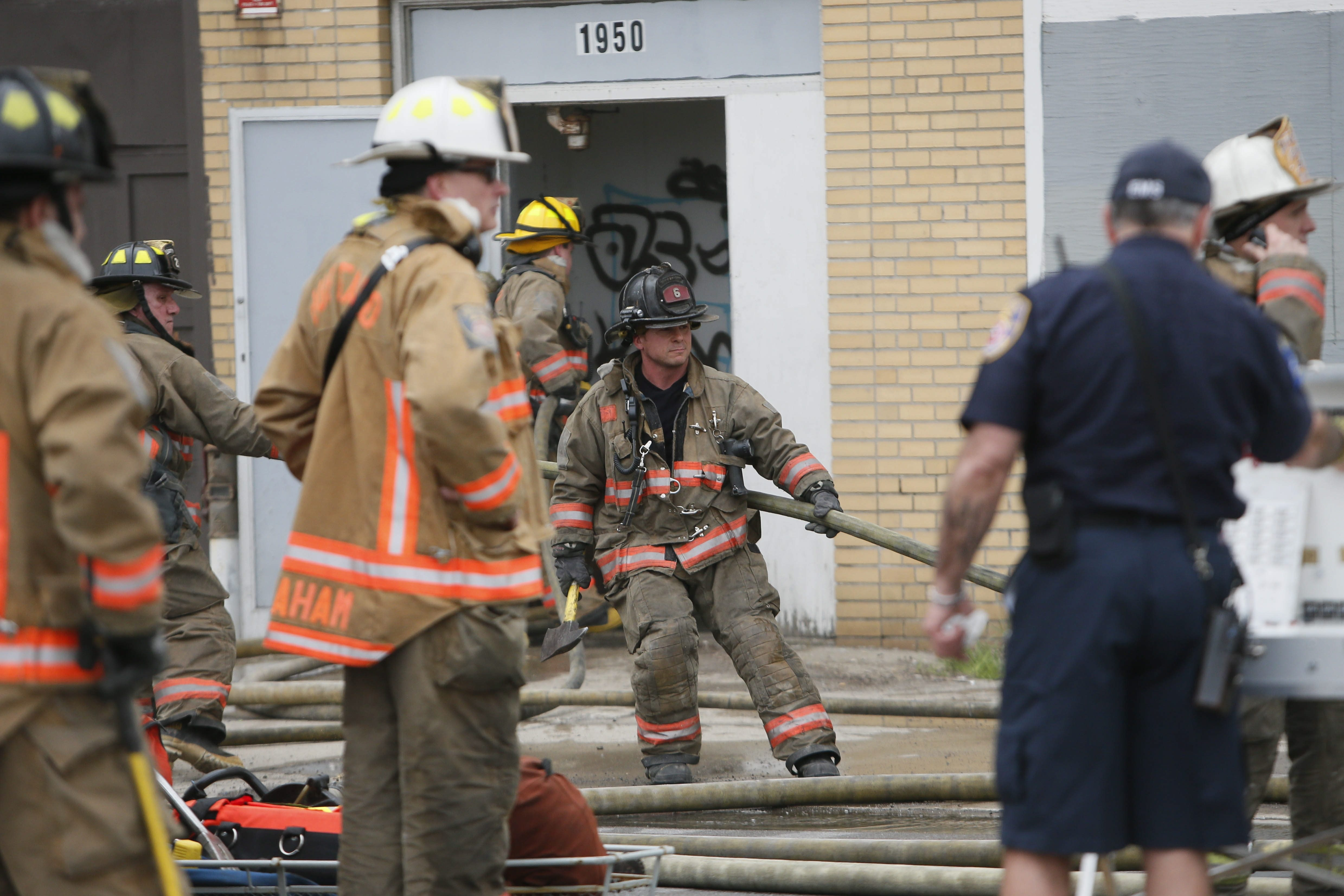 Buffalo firefighters respond to the fire at a vacant commercial building on Elmwood Avenue north of Hertel earlier today.