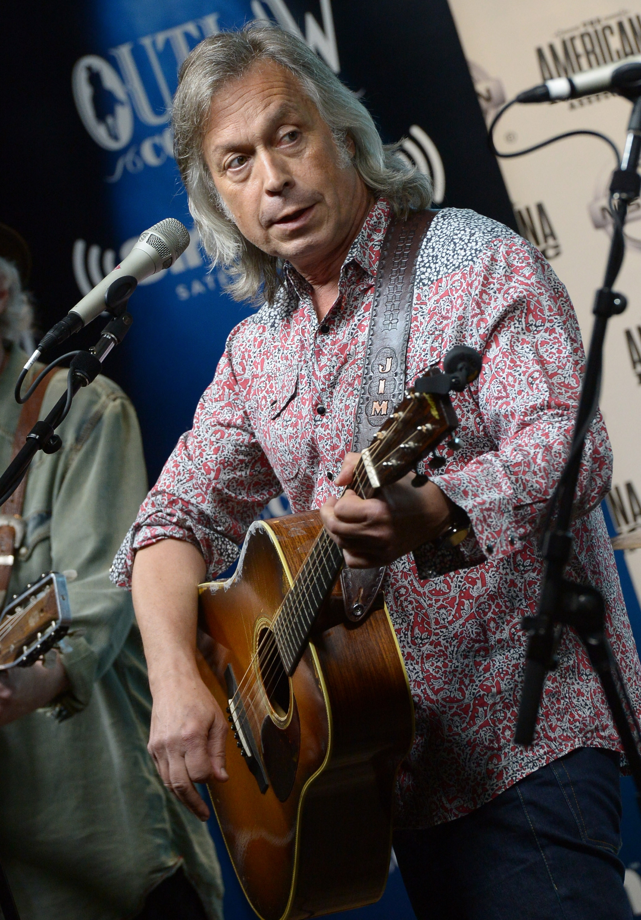 Rocking the house: Recording artist Jim Lauderdale performs at the Americana Music Association 2014 Award Nominees Announcement at SIRIUS XM Studio in Nashville.