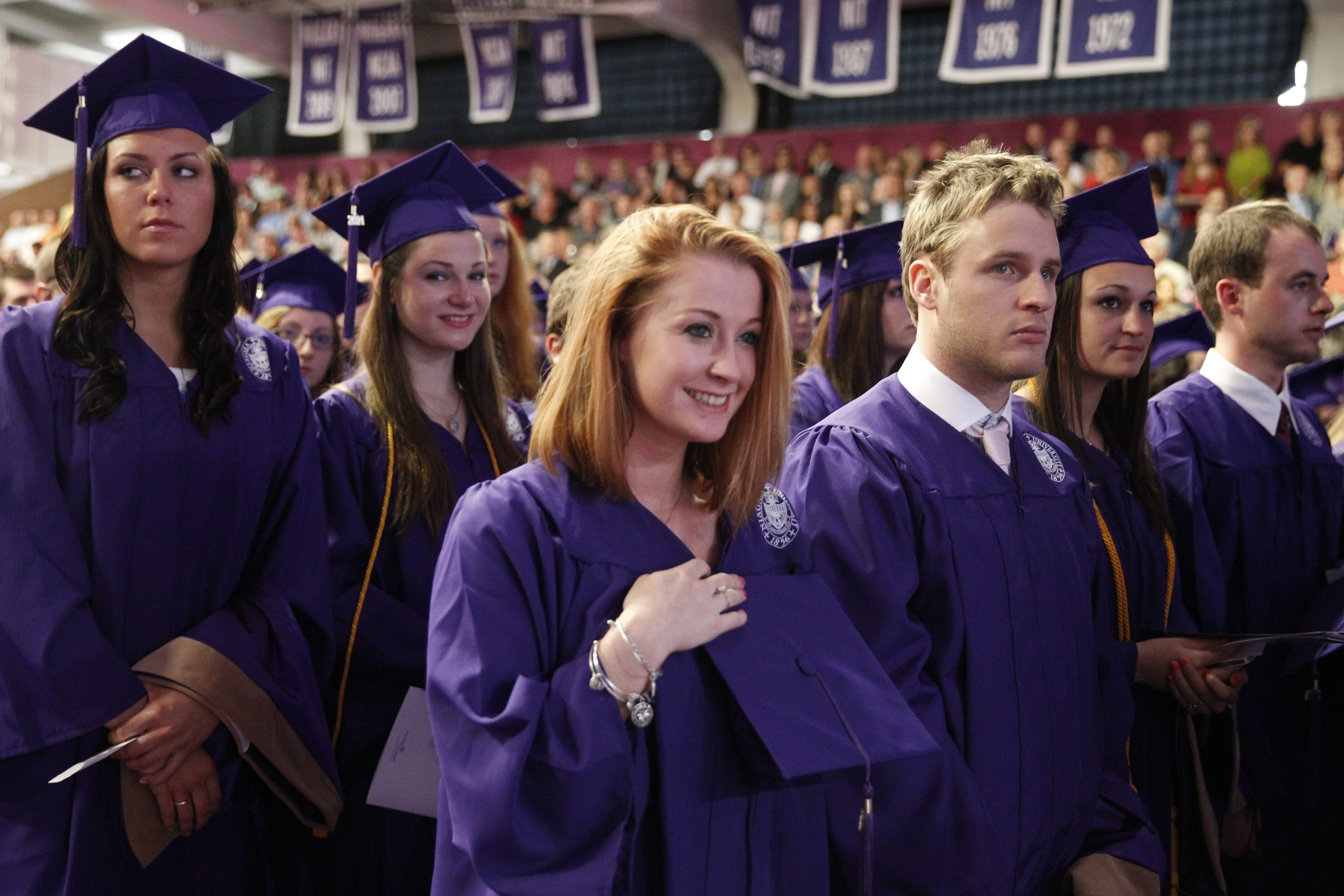 Courtney Dolan, foreground, of Rochester, stands with classmates Saturday at Niagara University College of Hospitality and Tourism Management's commencement ceremonies. Hilbert College, Niagara County Community College and Houghton College also held commencements Saturday. See more photos at buffalonews.com/galleries.