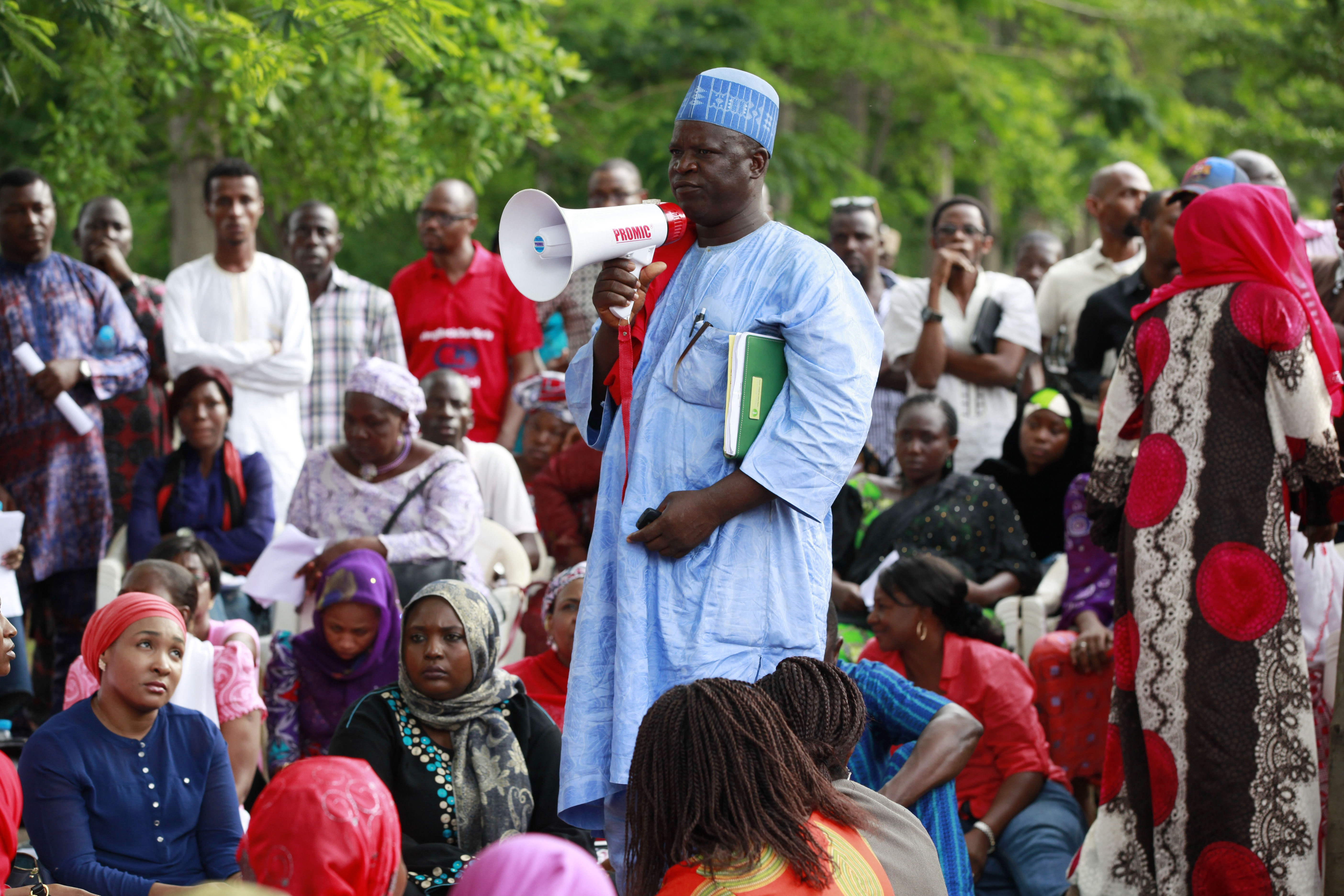 Hosea Abana, centre, the chairman of the  Chibok community in Abuja, Nigeria, pauses during a rally Saturday calling on the government to rescue the schoolgirls kidnapped from the Chibok Government secondary school. The president of Nigeria for weeks refused international help to search for more than 300 girls abducted by Islamic extremists.