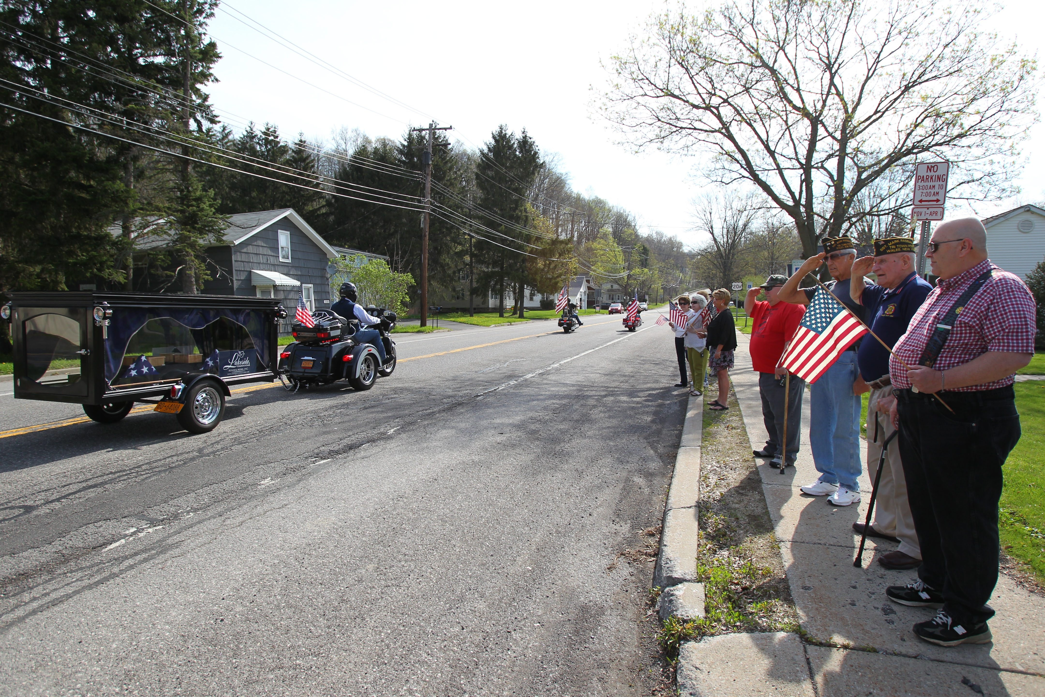 Members of  Wales VFW Post 7795 salute Patriot Guard Riders on Route 20A  Friday as they take the remains of four veterans  to Bath National Cemetery . See photo gallery at BuffaloNews.com.