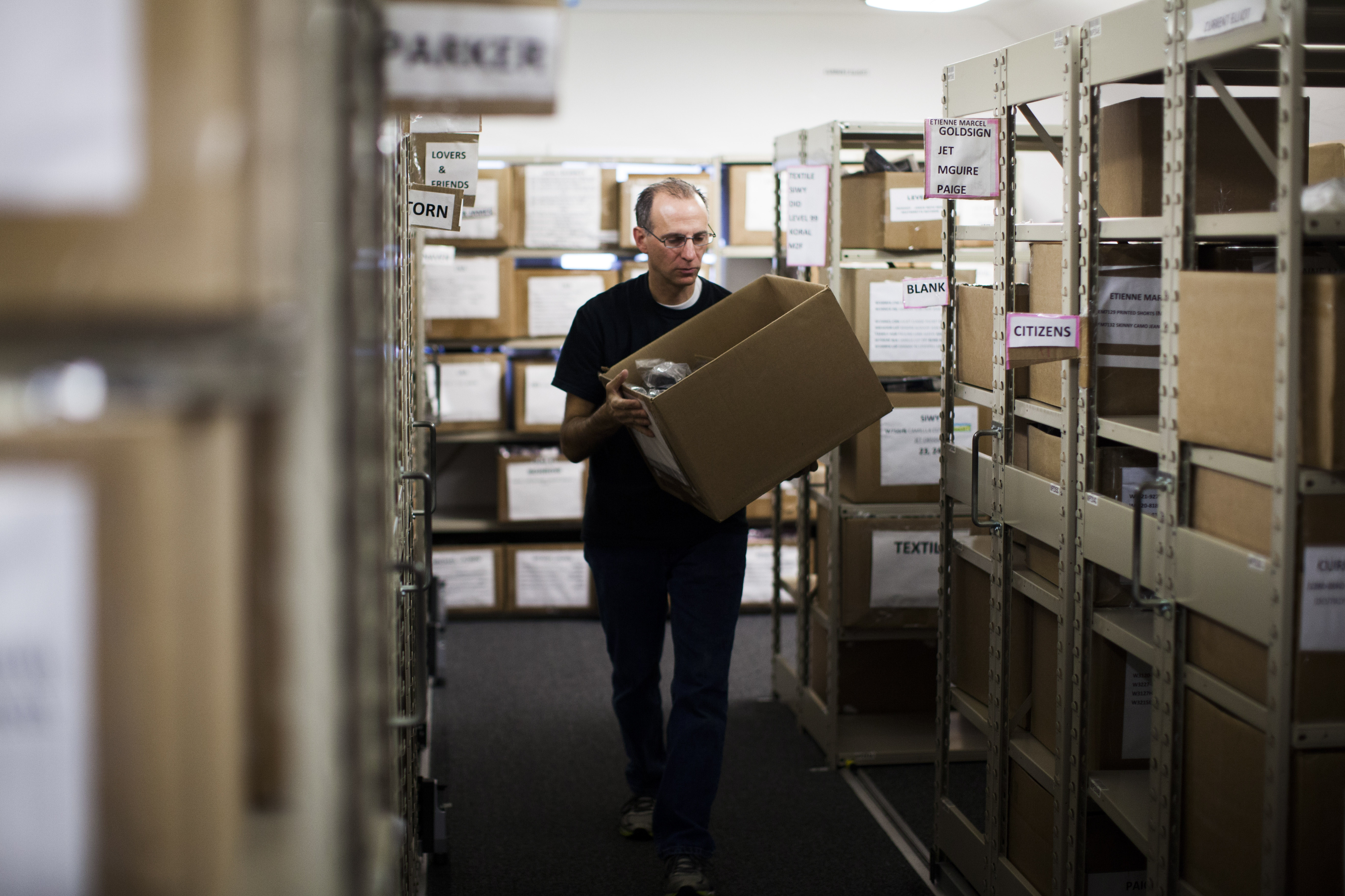 Bryan Sanders works in the warehouse of Singer22, a clothing store and online retailer, in East Hills, N.Y., on Friday.