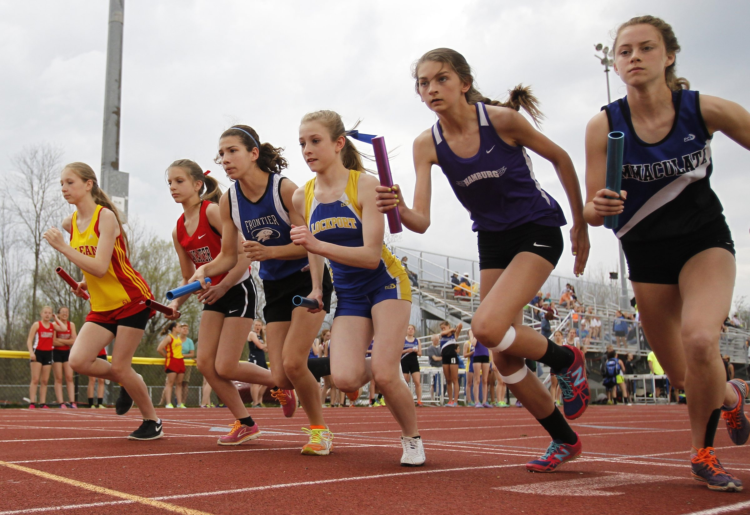 Runners start the first lap of the 4×800 relay during the Falcon Invitational at Frontier High School on Friday. Go to buffalonews.com for a photo gallery.