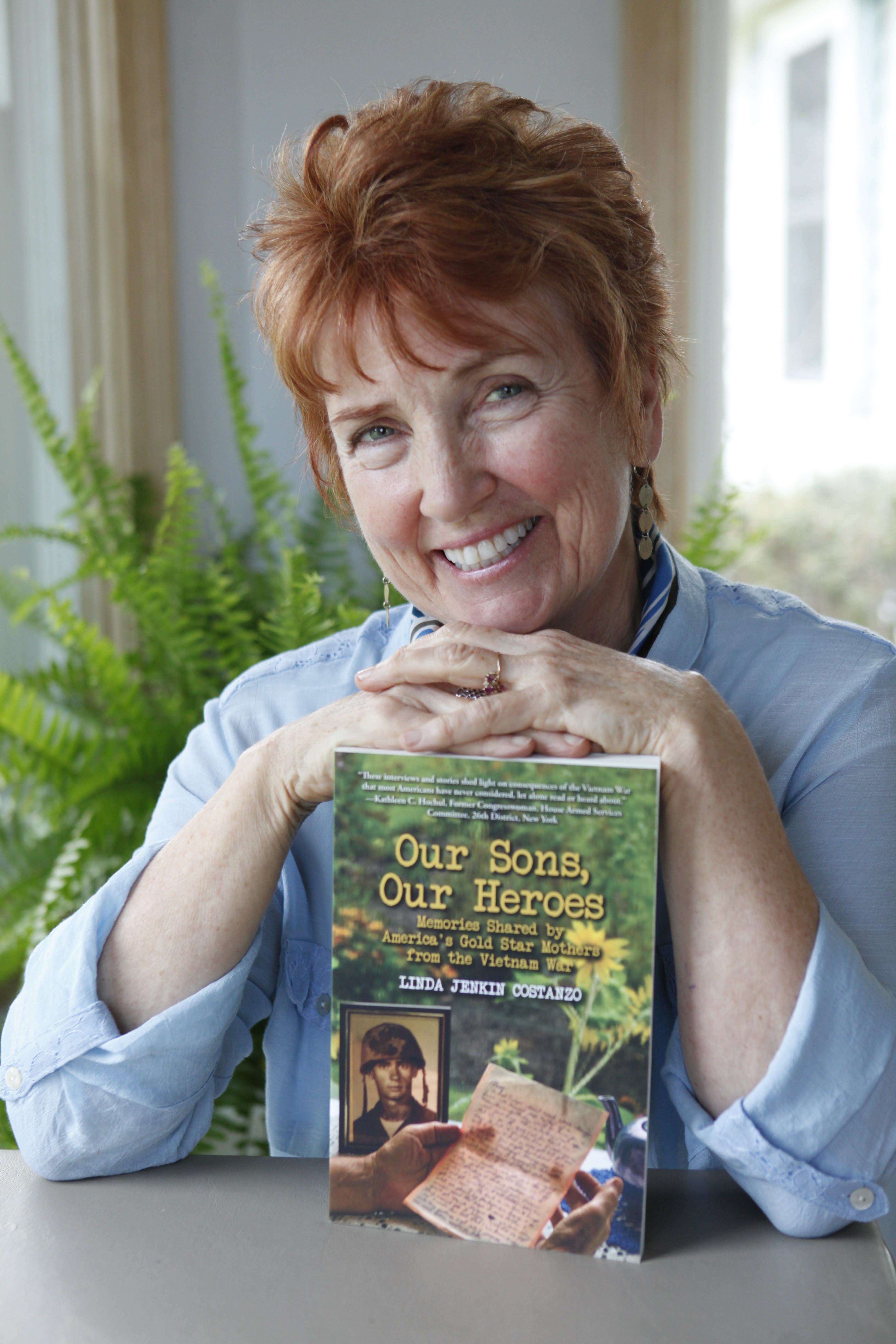 """Linda Jenkin Constanzo wrote the book """"Our Heroes, Memories Shared by America's Gold Star Mothers from the Vietnam War.""""  She was photographed at her home in Clarence, Monday, April 28, 2014.  (Sharon Cantillon/Buffalo News)"""