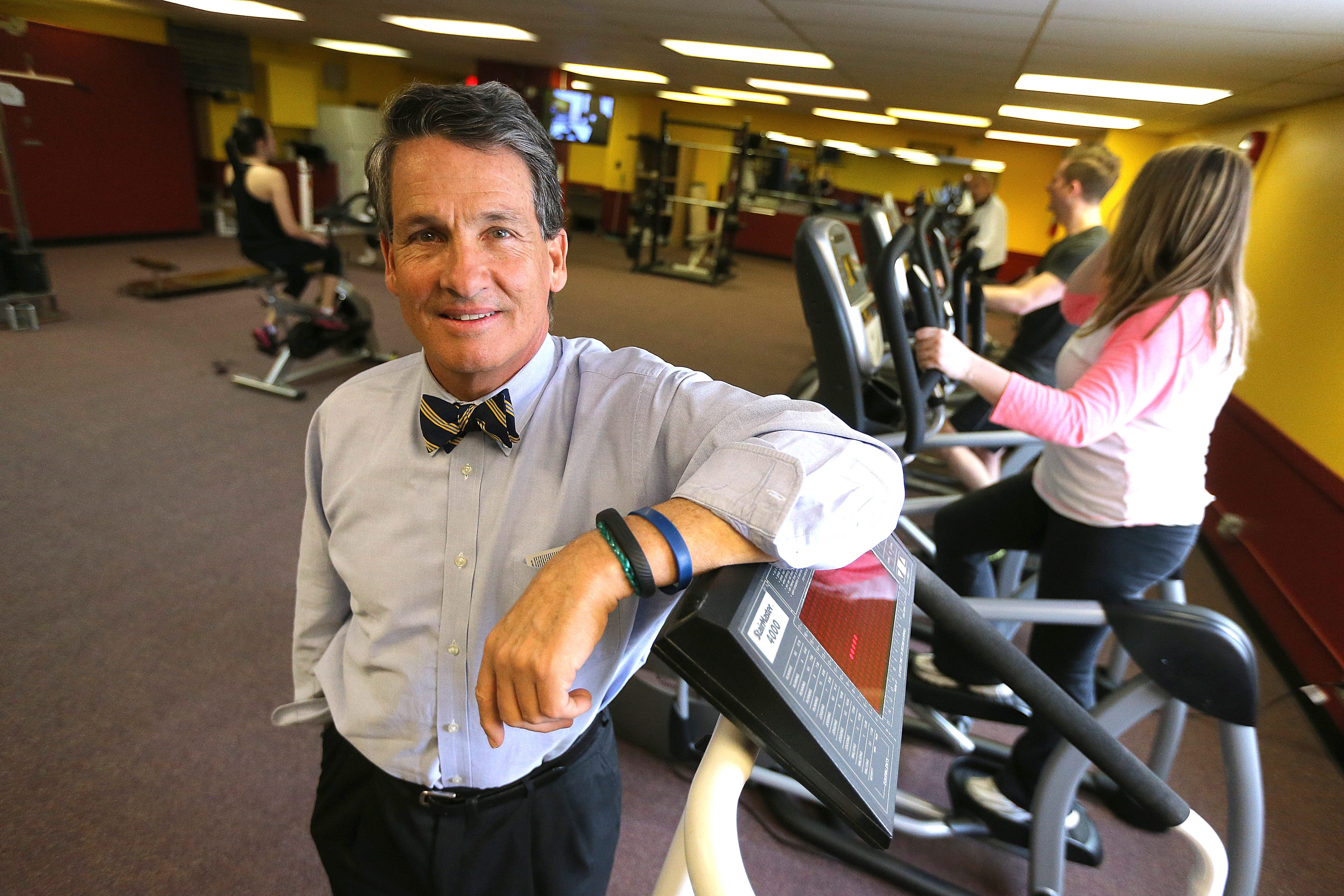 Edward F. Walsh, president of Walsh Duffield Cos., wears a personal fitness band on his wrist that syncs health statistics to his smartphone.