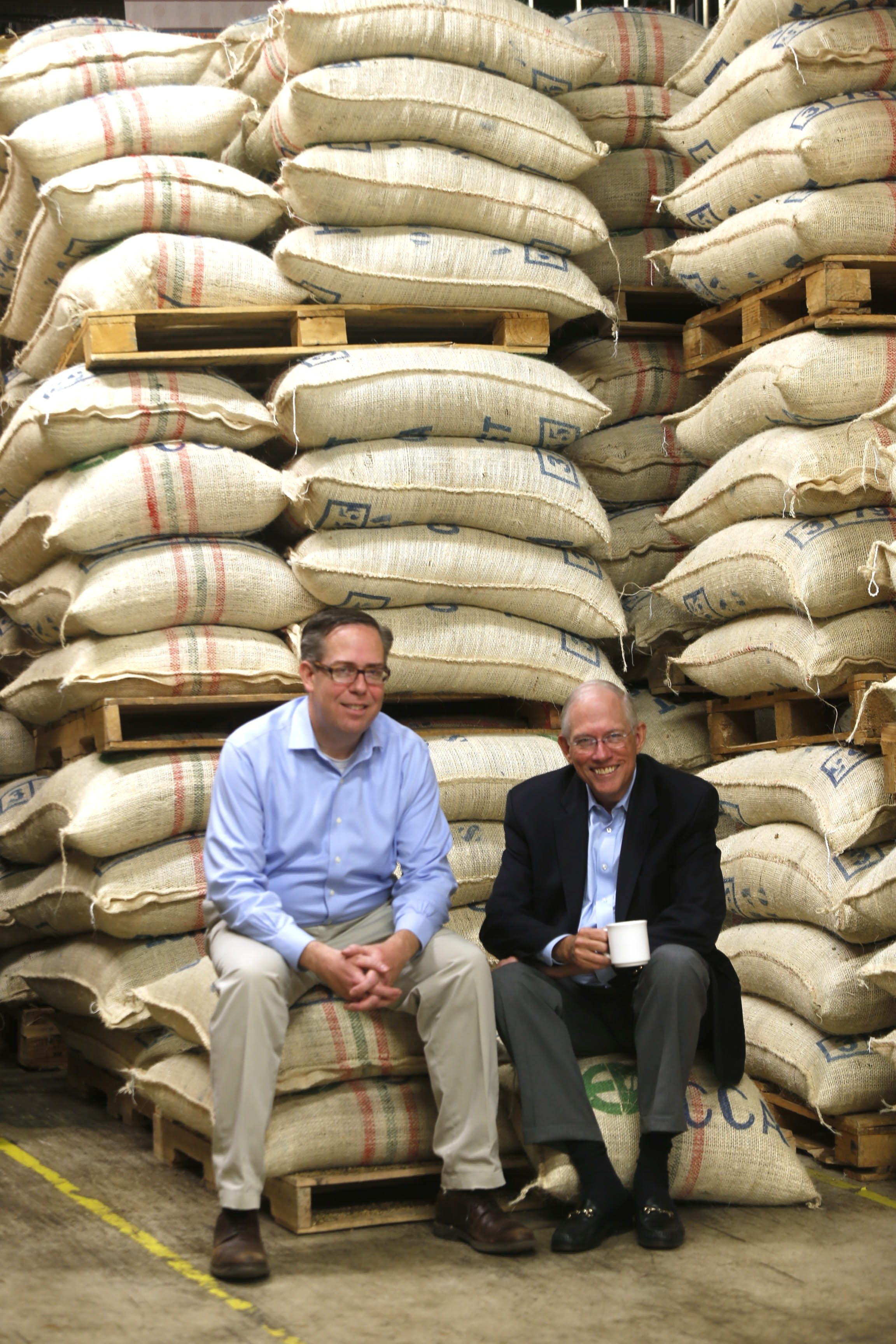 Warren Emblidge III, left, took over this year as president of McCullagh Coffee from his father, Warren Emblidge Jr.
