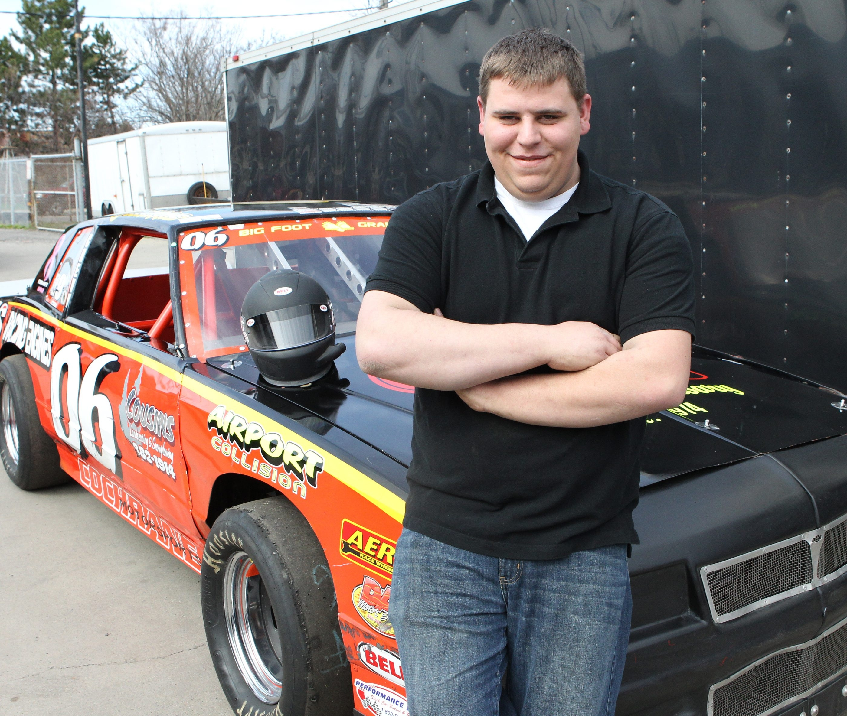 T.J. Cochrane poses with his race car at his auto shop on  Hertel Ave. in Buffalo.